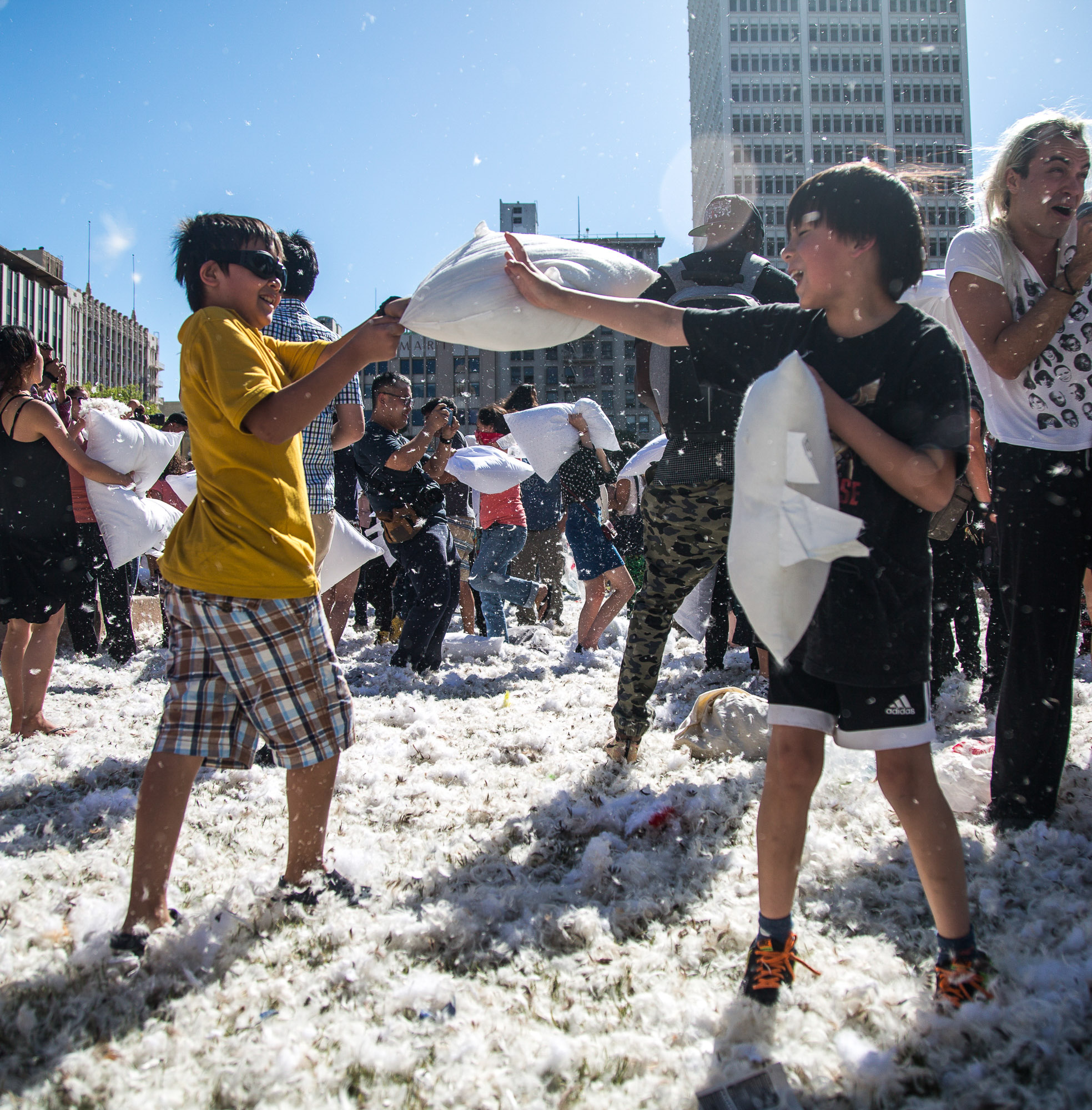 Two young pillow fight participants wage a pillow war on each other during the International Pillow Fight Day in Pershing Square in Downtown Los Angles on Saturday, April 1 2017. Hundreds of people traded soft blows in a giant pillow fight that dwarfed even the biggest slumber party slugfest. Children, teens, adults and seniors swung pillows at one another for over 2 hours during Saturdays event. (Corsair Photo: Matthew Martin)