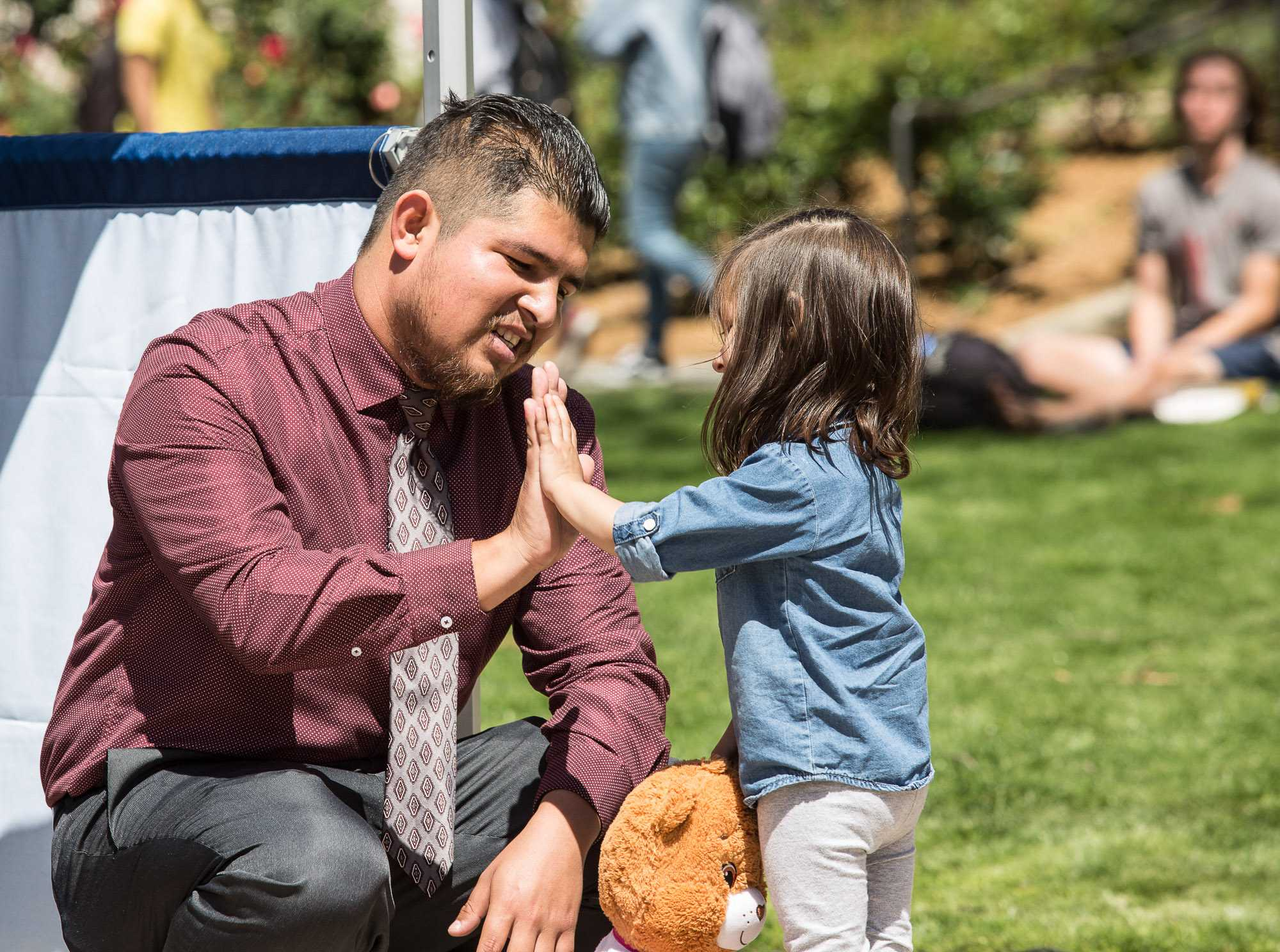 President of the Home Boys and Home Girls Club Edgar Mauricio Gonzalez gets a high five from his daughter after campaigning for Associated Student (A.S.) Vice President during the A.S. debate which took place at the clock tower quad in Santa Monica Community College in Santa Monica Calif., on Tuesday, March 28, 2017. Gonzalez was announced as the A.S. Vice President on Friday, April 7, 2017.(Photo by Matthew Martin)