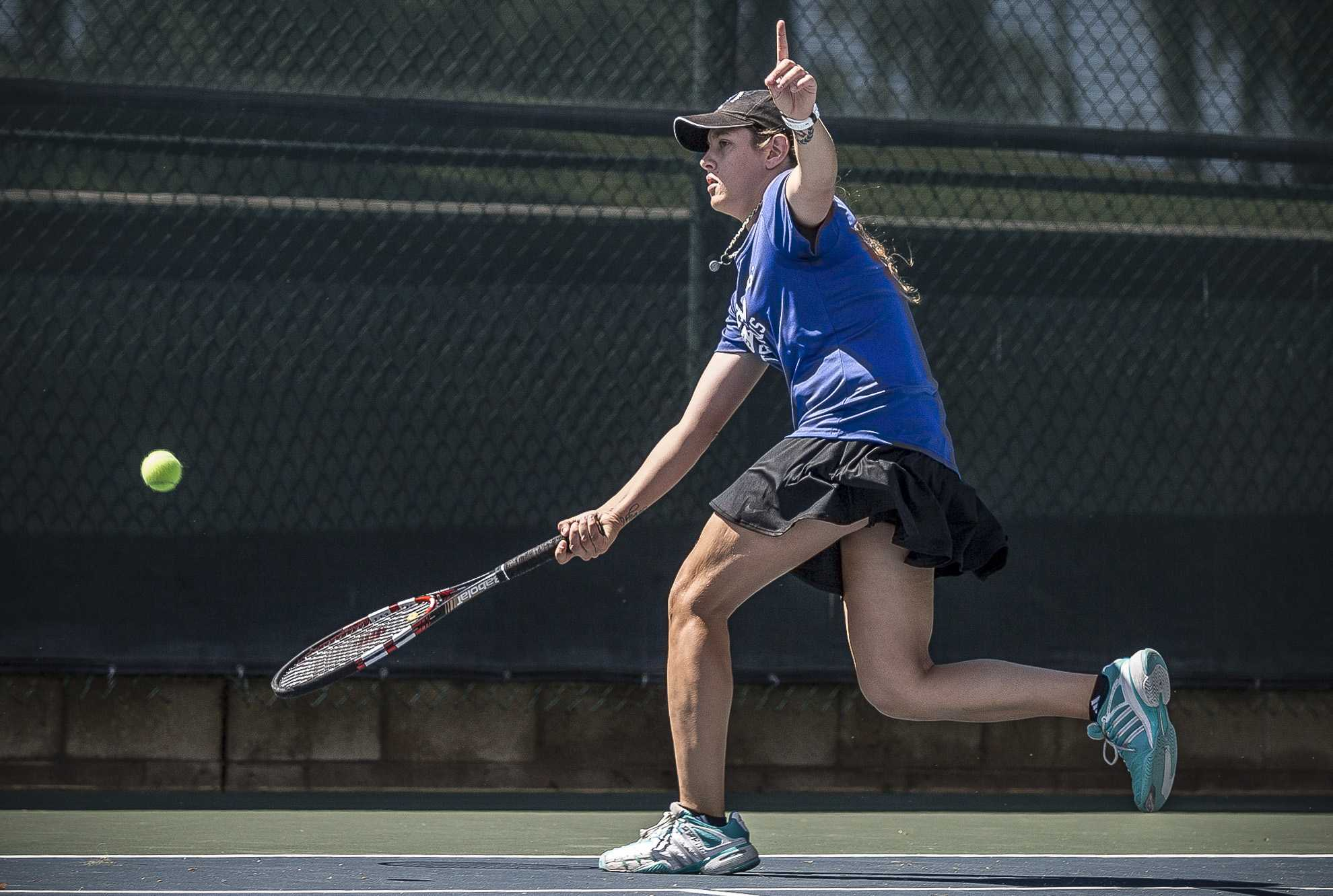 Santa Monica College Corsair sophomore Mayra Jovic (#1, singles) is about to attempt to hit a forehand shot but stops and points out that her Ventura College opponent had hit the ball out of bounds during her 2 – 0 (6-0, 6-0) set victory, which was part of the Corsairs 7 – 1 blowout over the Ventura College Pirates at the Ocean View Park Tennis Courts in Santa Monica Calif., on Thursday, March 23 2017. (Corsair Photo: Matthew Martin)
