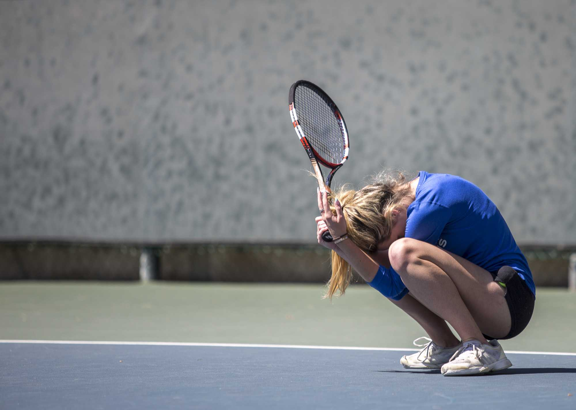 Santa Monica College Corsair freshman Abby Mullins (#2, singles) crouches down in frustration as she loses a game during her 2–0 (6-2, 6-1) set victory, which was part of the Corsairs 7–1 victory against the Ventura College Pirates at the Ocean View Park Tennis Courts in Santa Monica California, on Thursday, March 23, 2017. (Corsair Photo: Matthew Martin)