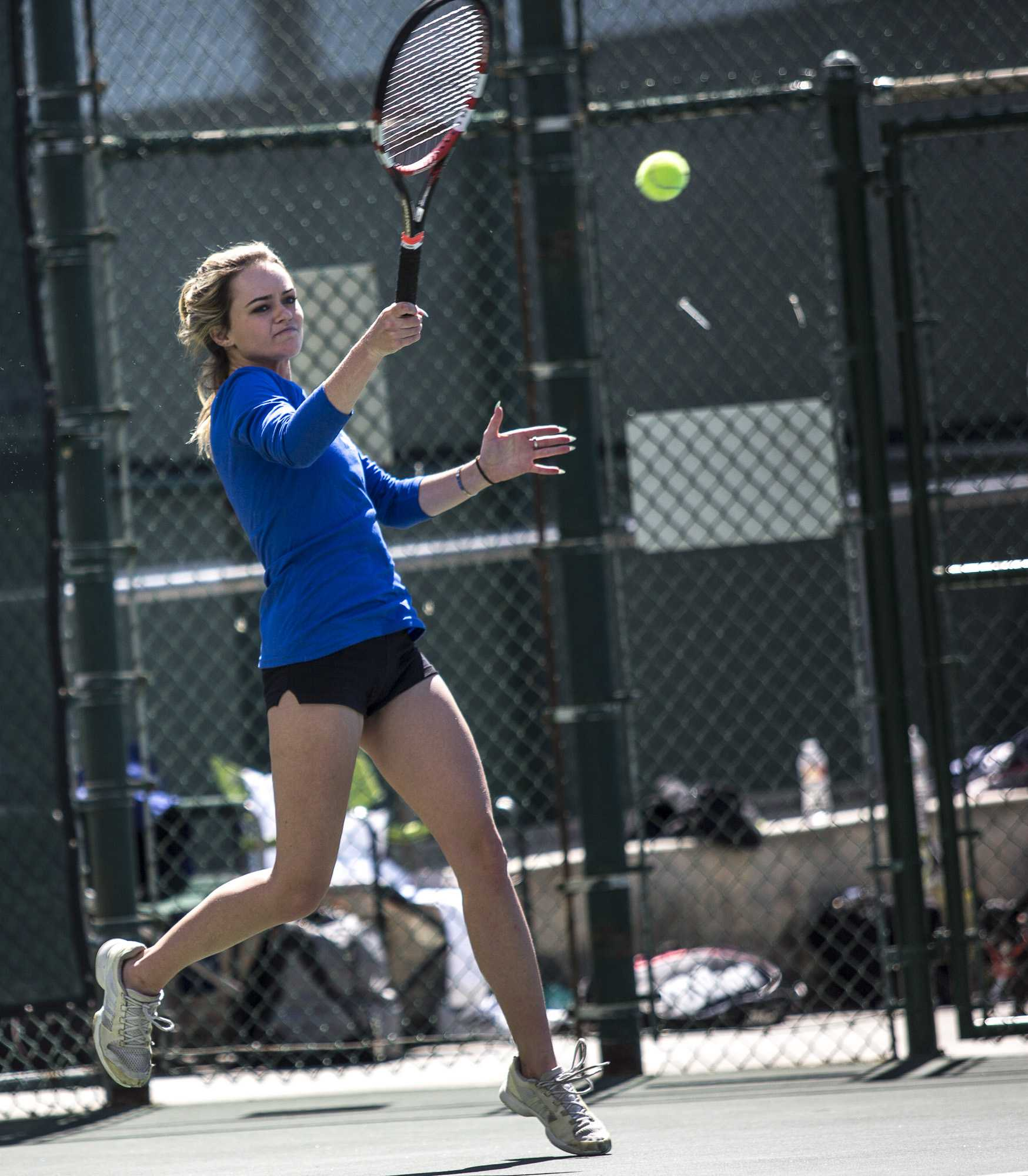 Santa Monica College Corsair freshman Abby Mullins  (#2, singles) hits a high forehand (hard shot) at her Ventura College Pirate opponent during her 2 – 0 (6-2, 6-1) set victory, which was part of the Corsairs 7 - 1 blowout victory against the Ventura College Pirates at the Ocean View Park Tennis Courts in Santa Monica Calif., on Thursday, March 23 2017. (Corsair Photo: Matthew Martin)