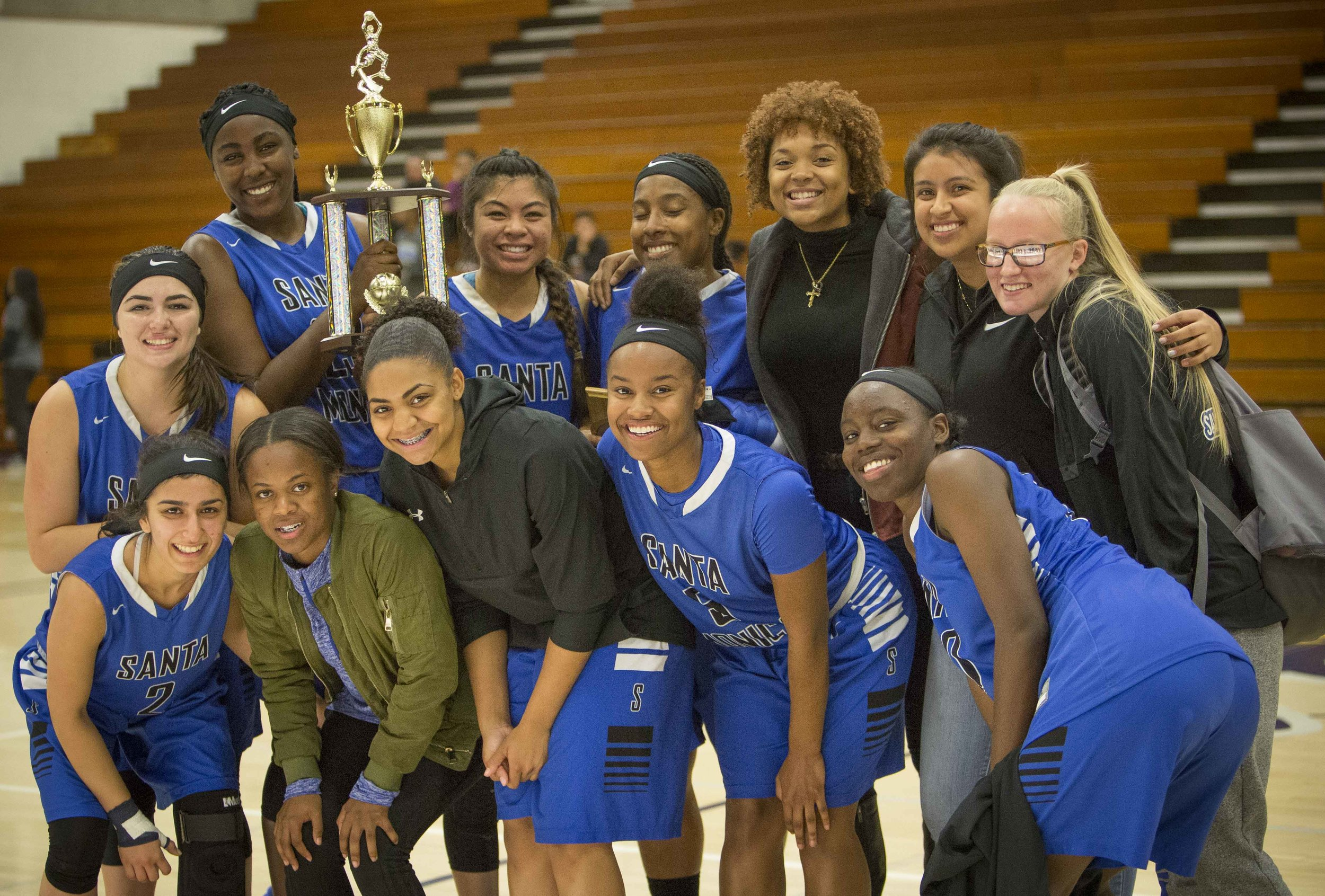 December 4th 2016. The Santa Monica College Corsair Womens Basketball team posing with thier trophy win against The Citrus College Owls in the 33rd annual Lady Charger Classic basketball tournament hosted by Cypress College in Cypress, Calif.. The Corsairs would win 74-69 earning them third place in the tournament. Photo by Daniel Bowyer.