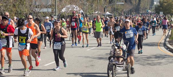 Over 24,000 people participated in 32nd annual L.A. Marathon on Sunday, March 19, 2017. Runners arrive at 18-mile checkpoint in Beverly Hills, California. Ethan Chuang