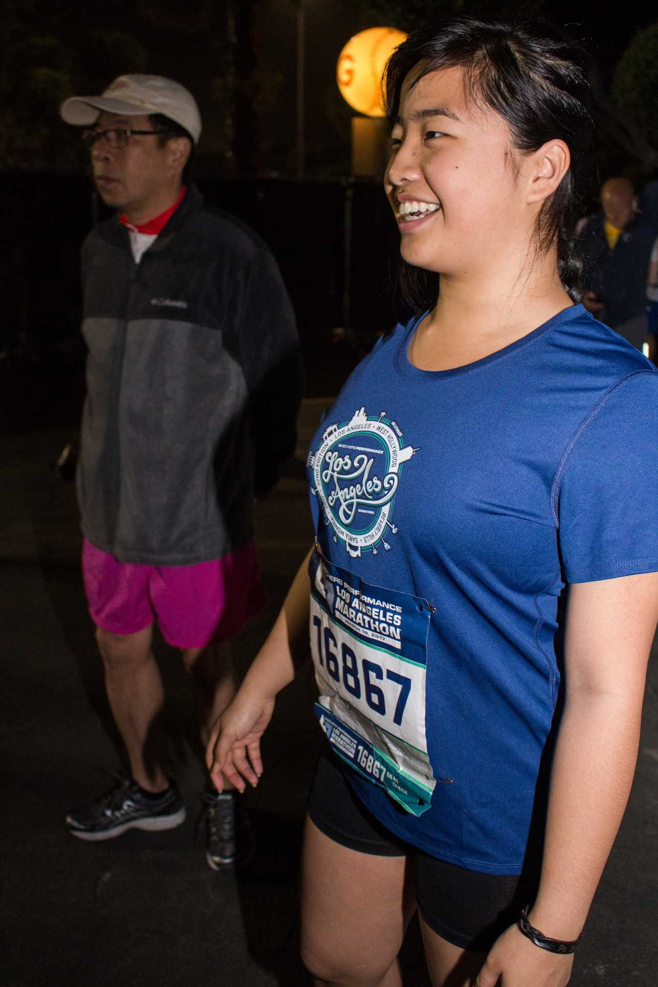 Santa Monica College Acssociated Students Activities Director, Kathy Pho (right) and her father Que Pho (left) converses with thei family as she prepares for the 2017 Skechers Performance LA Marathon on Sunday March 19, 2017 at the Dodger Stadium in Los Angeles, CA. Photo by Marisa Vasquez.