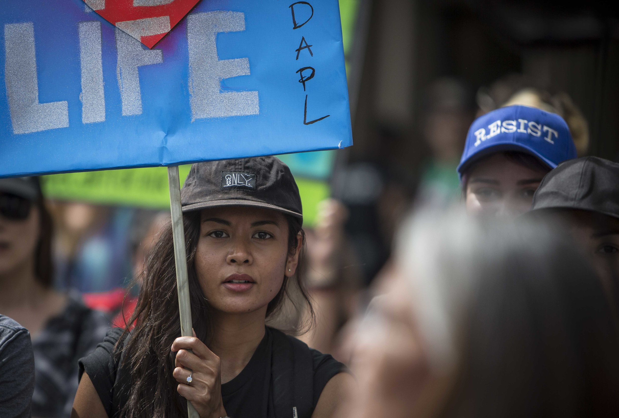 An protester holdind a sign about the Dakota Access  Pipeline prepaing to march from Pershing Square to City Hall in Downtown Los Angles, Calif., on Friday March 10, 2017.  Photo by: Daniel/Corsair Staff