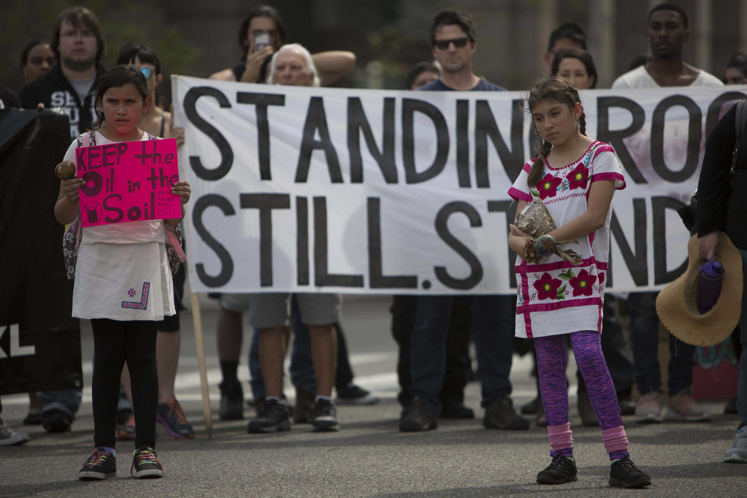 A yound child holdind a sign about wantin no oil drilling near the Dakota Access  Pipeline marching with her friends from Pershing Square to City Hall in Downtown Los Angles, Calif., on Friday March 10, 2017.  Photo by: Daniel/Corsair Staff