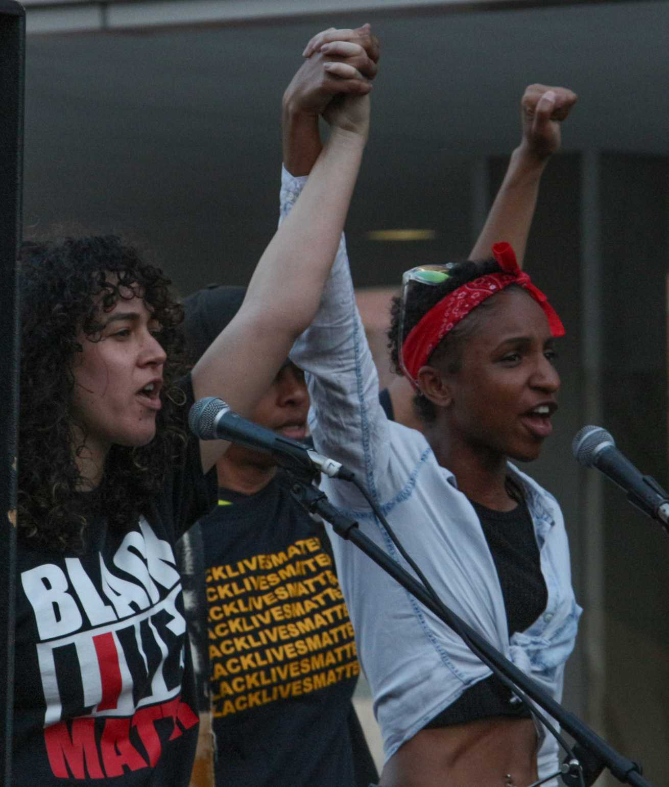 """Black Lives Matter leaders leading a chant, """"Remember the lives lost to police brutality,""""  at the Women's strike in Downtown Los Angeles, California on March 8th (photo by José Aguila)"""