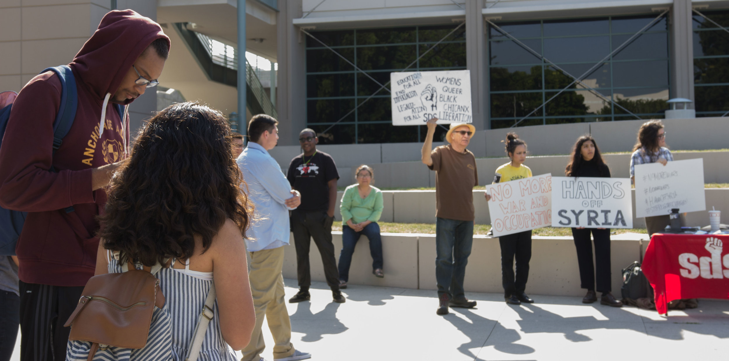 A crowd gathers to gain information and show support at the Hands Off Syria protest at Pasadena City College in Pasadena California on April 11, 2017 (Photo By: Zane Meyer-Thornton)