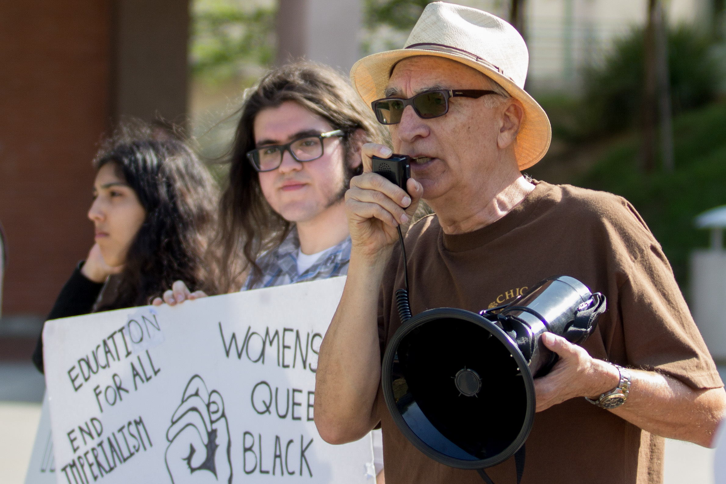 Guest speaker and Community Service Organization member Carlos Montez (right) speaks on his beliefs of US imperialism as Lorenzo Osterhein (center) and Lourdes Fuentes (left) listen in at the Hands Off Syria at Pasadena City College in Pasadena California on April 11, 2017 (Photo By: Zane Meyer-Thornton)