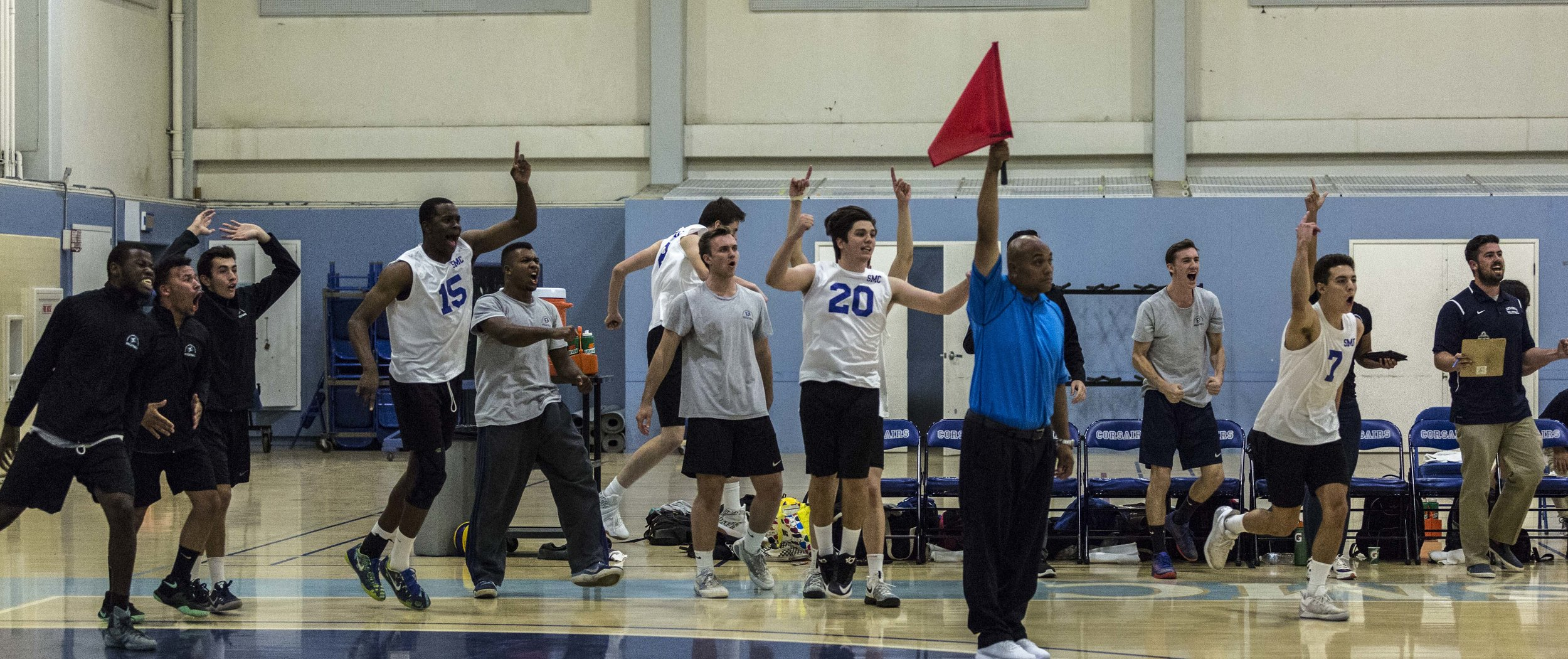 The Santa Monica Corsairs bench celebrates their match winning point (3-2) against The Pierce College Brahmas in the Santa Monica College gymnasium in Santa Monica Calif., on Friday, April 21 2017. The Corsairs however would go on to win the game 3-2, which would allow the Corsairs to advance to the second round of the CCCAA playoffs. (Corsair Photo: Matthew Martin)