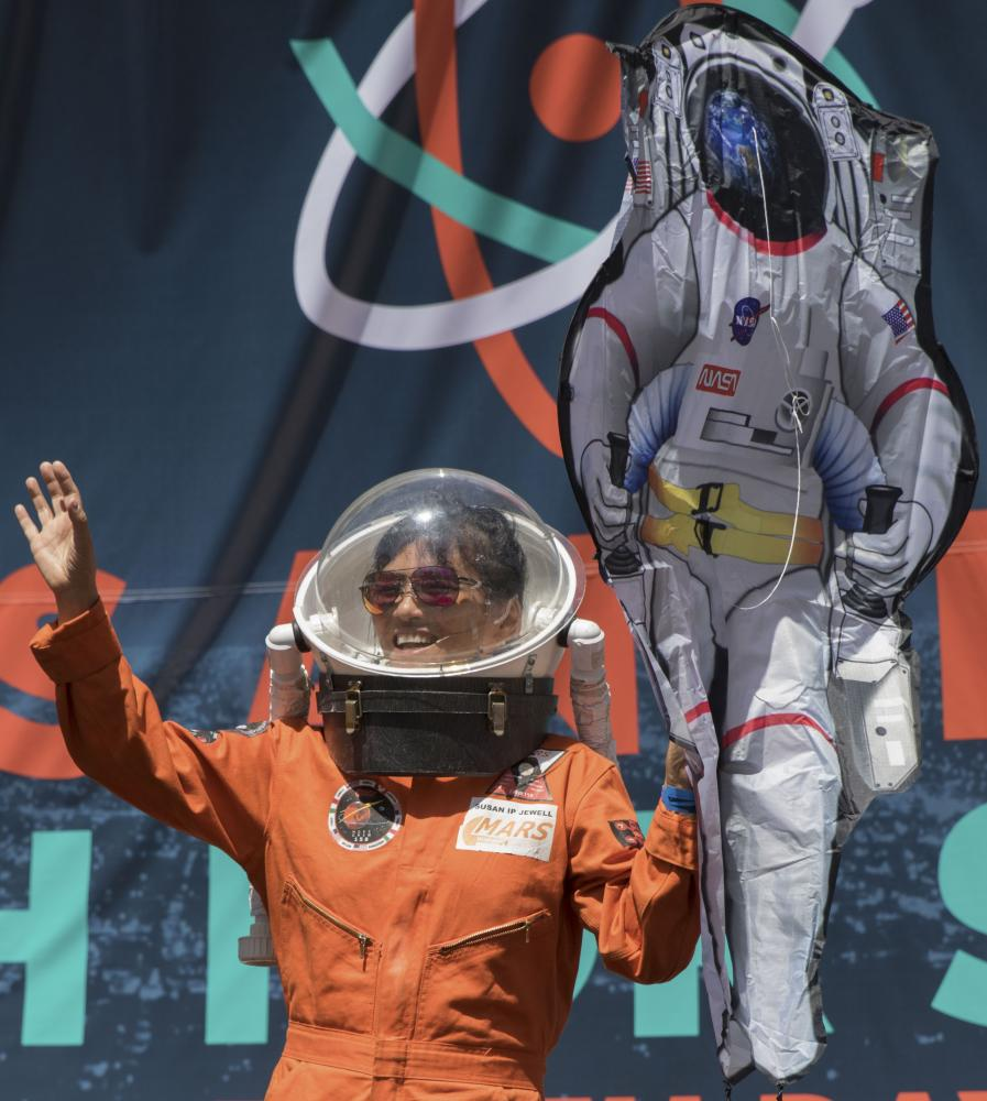 Speaker at the Earth Day Protest Susan Jewell talks about future expeditions to Mars to show the importance of science at the Earth Day Protest in downtown Los Angeles, California on April 22, 2017. Zane Meyer-Thornton.
