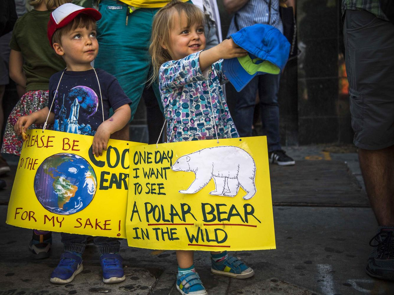Twins Matthew (left) and Vanessa (right) Bell anxiously wait for the March for Science event to begin while holding signs in Pershing Square in Downtown Los Angles California, on Saturday April 22, 2017. Matthew Martin.