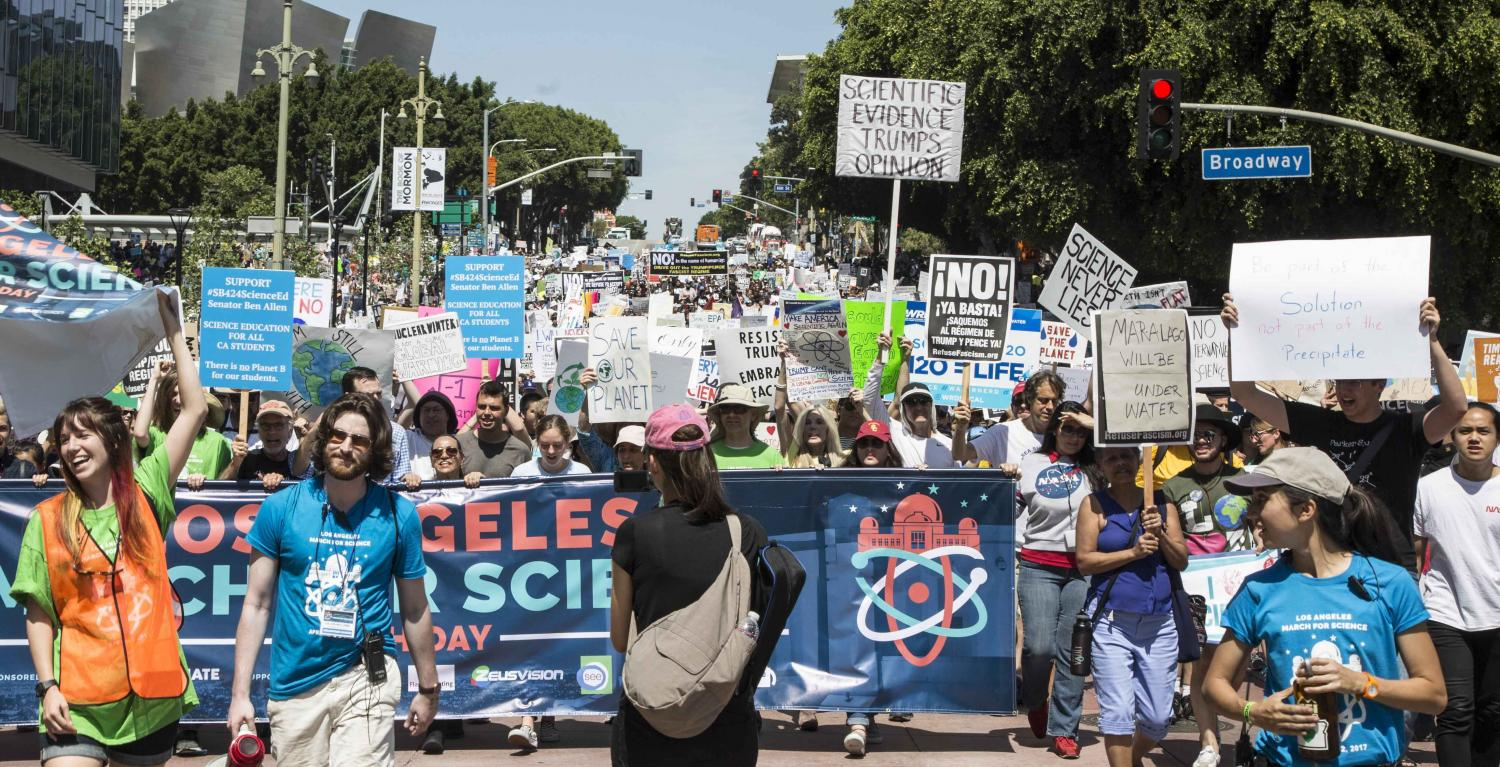 """Nearly 50,000 protesters took part in the March for Science in Los Angeles marching down Hill Street chanting, """"Science not Silence"""" while holding up the March for Science organizational banner as they make their way to Los Angles City Hall in Downtown Los Angles, California, on Saturday, April 22 2017. Matthew Martin."""