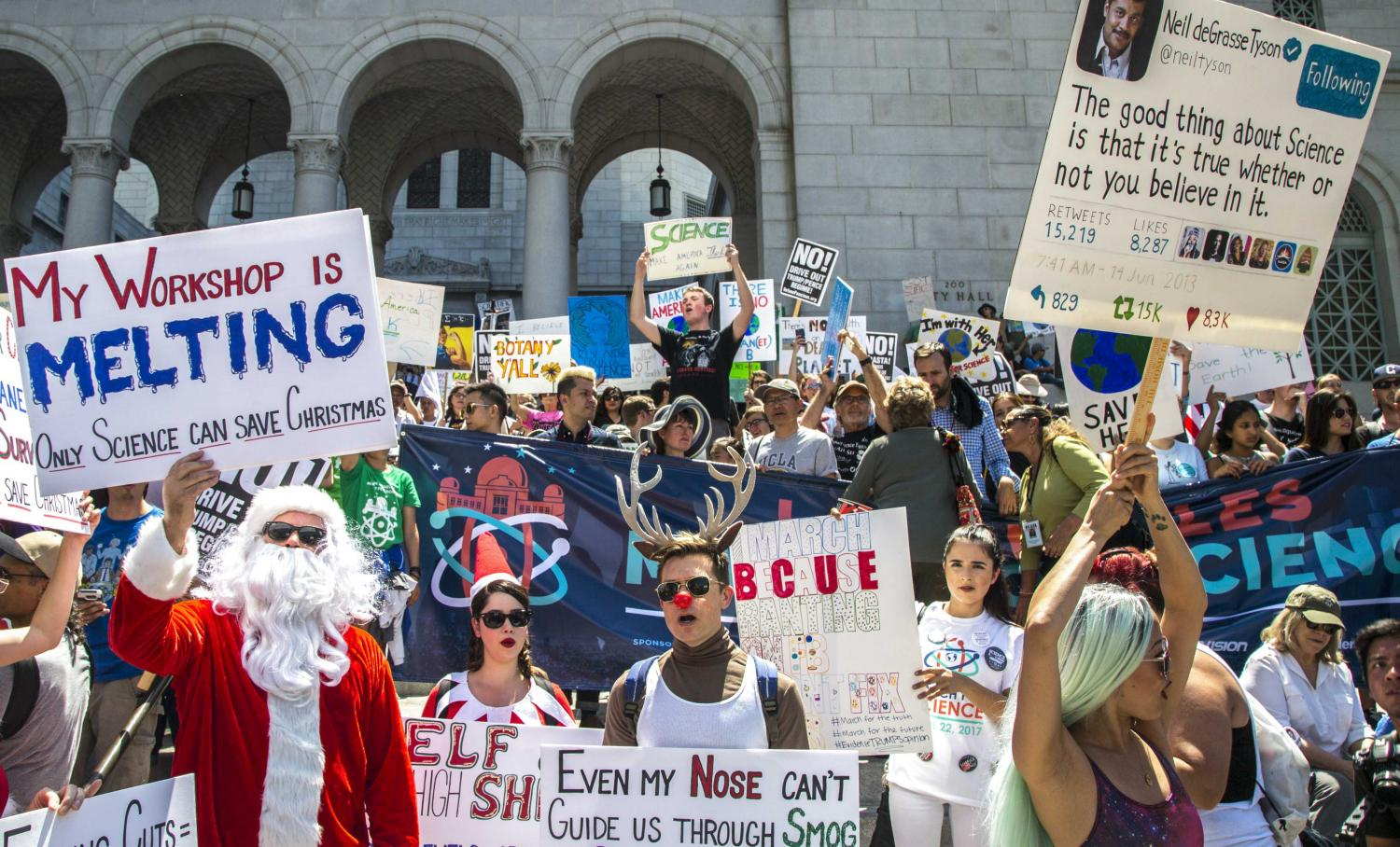 Thousands of protesters arrive at Los Angles City Hall and make their presence felt by chanting and holding up their signs as they wait for key speakers during the March for Science event in downtown Los Angles, California, on Saturday, April 22 2017. Matthew Martin.