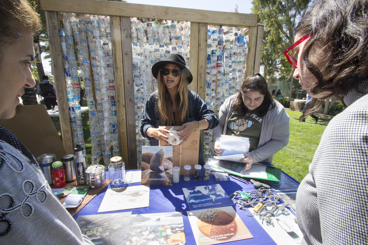 Plastic Free SMC had many examples of what happens to plastic that is discarded and the damages it can do to the ocean. Bronwyn  Hancock Major (center) is Vice Presicent and ICC delicate, along with Sally Marcadl club member, they talk to students about the impacts of plastic pollution during Earth week at Santa Monica College, Apil 20, 2017. (Jazz Shademan)