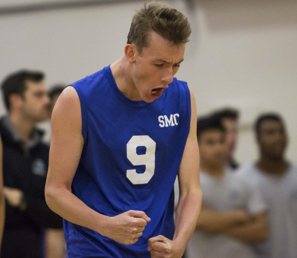 Santa Monica College Corsairs mens volleyball Middle Hitter, Bradley McCallister (9), celebrates a point made by the Corsairs during the Califonia Community College Athletics Association playoff game against the Orange Coast College Pirates at Pierce College in Woodland Hills, California. April 27, 2017. Marisa Vasquez.