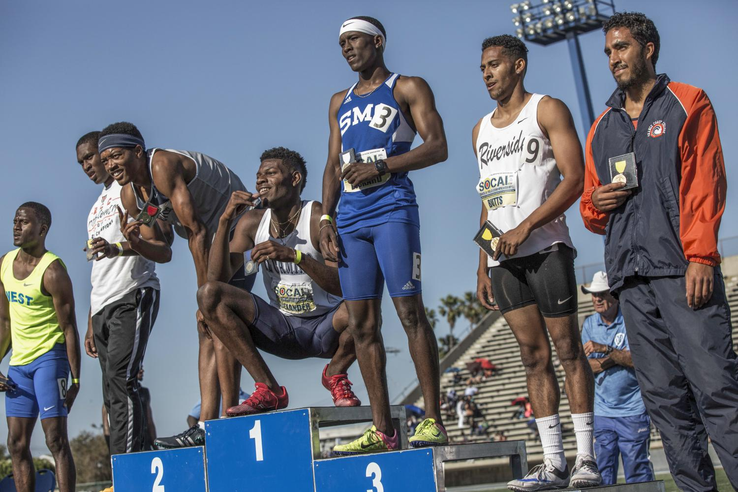 California pose for the cameras while showing off the medals they received in the Men's 400m Hurdle during the So Cal track and field finals in the Cerritos College field in Norwalk, Calif., on Saturday, May 13, 2017. Our Santa Monica College Corsair sophomore athlete Devyn Deckard (#3, Blue) receives his 3rd place medal for the Men's 400m Hurdle during the So Cal track and field championships. (Matthew Martin)
