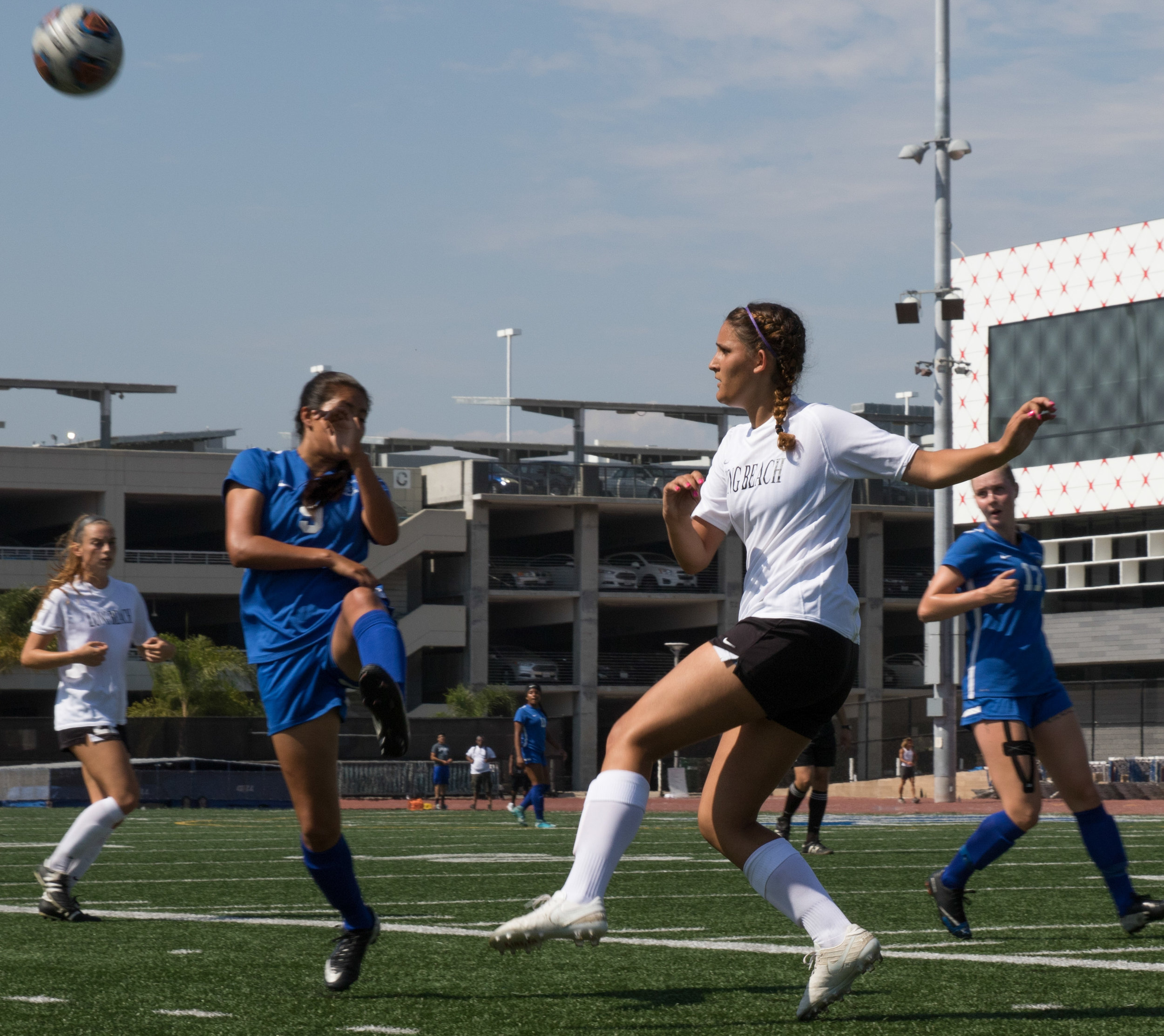 Santa Monica College Corsairs freshman midfielder Ashley Martinez (9, middle) battles for the ball with Long Beach City College Vikings Sophomore Defender Maria Vitiello (right) in their 1-1 draw on August 29, 2017 at the Santa Monica College Football field on the Santa Monica College main campus in Santa Monica California (Photo By: Zane Meyer-Thornton)