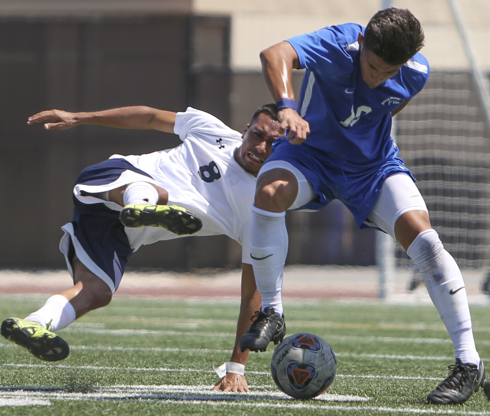 Oscar Palacios (10) of the Santa Monica College Corsairs mens soccer team fights for possesion of the ball against Everardo Candelas (8) of the El Camino College Warriors, Friday, September 1st, 2017, at the Santa Monica College Main Campus field in Santa Monica, California. The Corsairs beat The Warriors 5-1. (Daniel Bowyer/Corsair Staff)