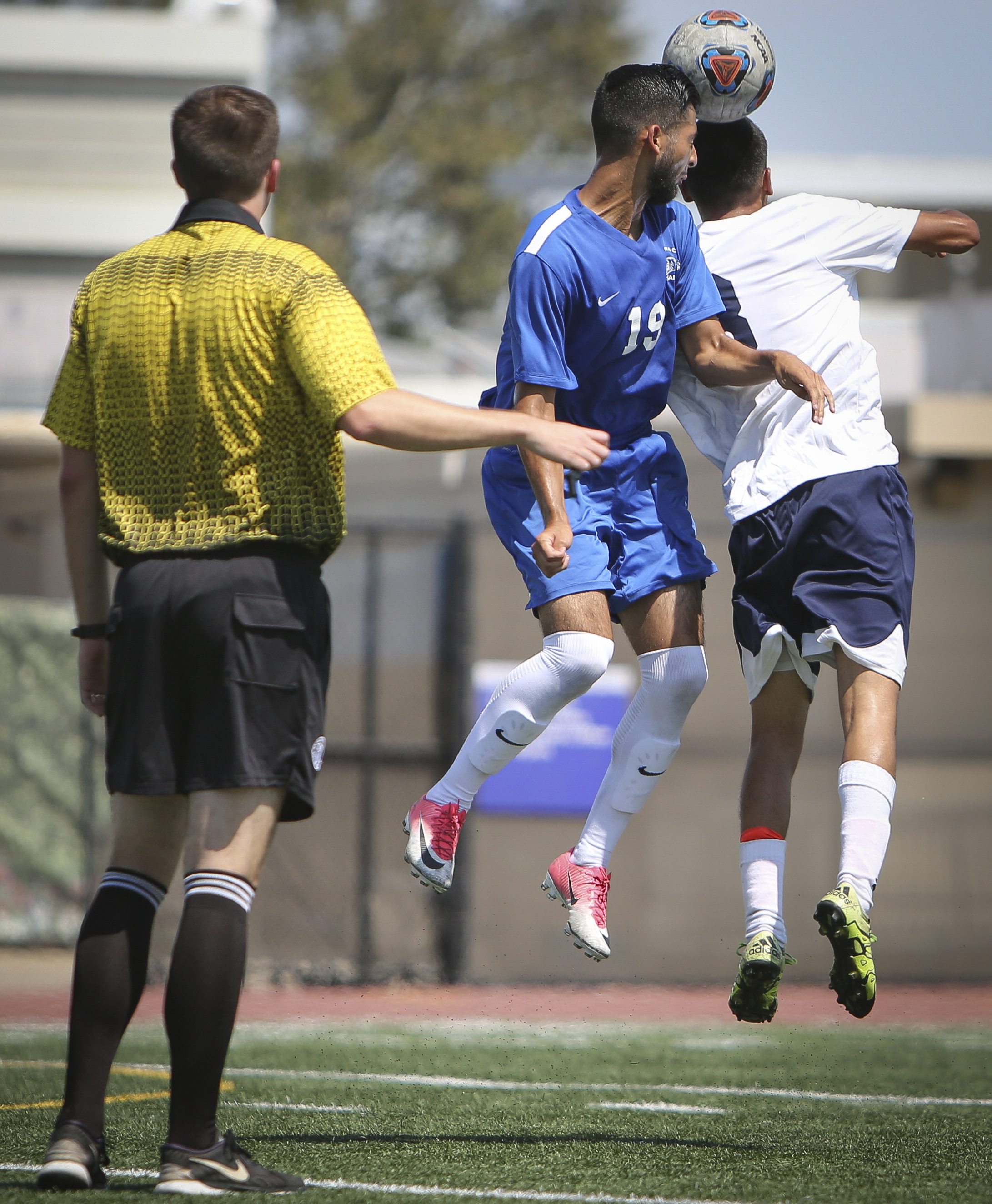 Giancarlo Canas-Jarquin (19) of the Santa Monica College Corsairs mens soccer team fights for possesion against Everardo Candelas (8) of the El Camino College Warriors, Friday, September 1st, 2017, at the Santa Monica College Main Campus field in Santa Monica, California. The Corsairs beat The Warriors 5-1. (Daniel Bowyer/Corsair Staff)