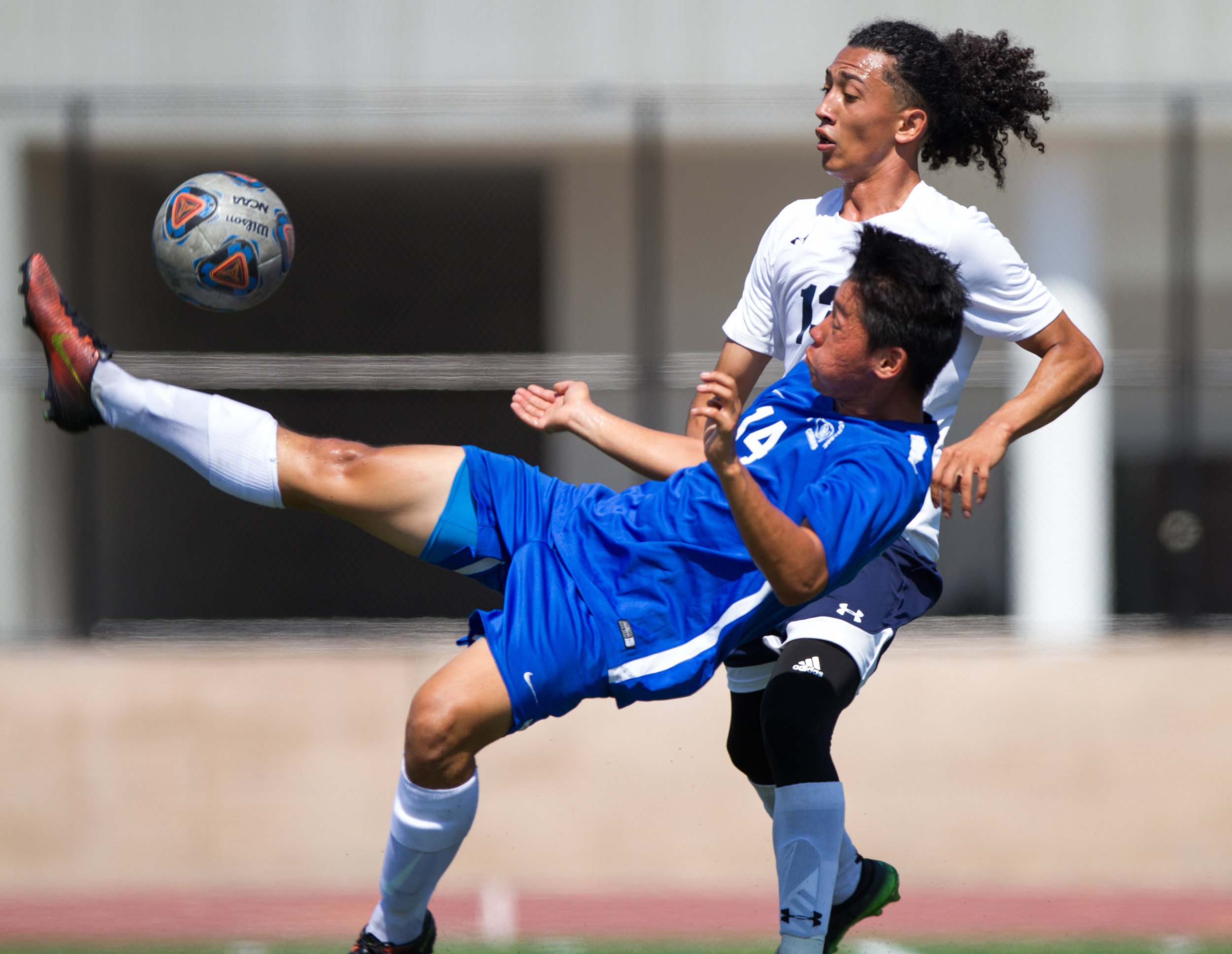 Santa Monica Corsair Narciso Cervantes (14) kicks the ball as he competes for possession against El Camino Warrior John Cerda (13) on September 1, 2017 on the Corsair Field at Santa Monica College in Santa Monica, California. The Corsairs take home a win against the Warriors 5-1. (Jose Lopez)
