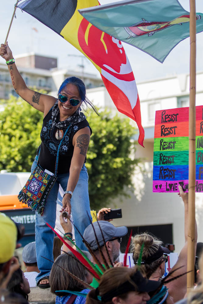 Lydia Ponse helps keep the massive group of DACA supporters stay organized as part of the No DACA rally in Downtown Los Angeles on September 10, 2017 (Photo By: Zane Meyer-Thornton)