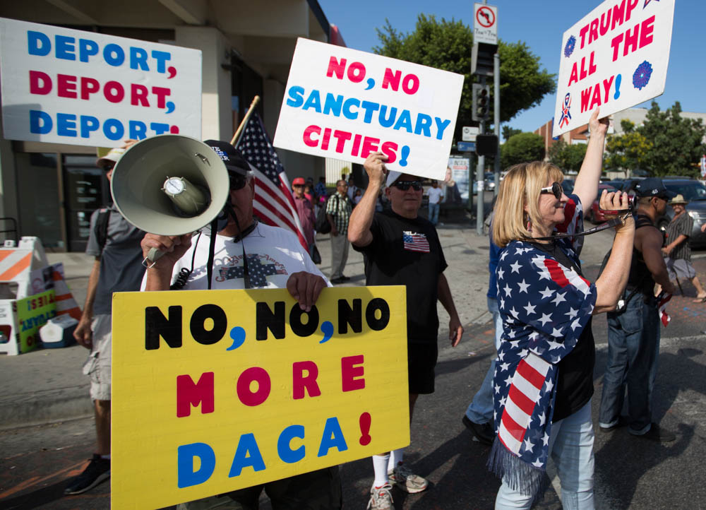 Anti-Immigrant protesters gather at the corner of 6th street and Alvarado as a counter-protest to the pro-DACA march and rally taking place on September 10, 2017 at MacArthur Park in Los Angeles, California. (Jose Lopez)