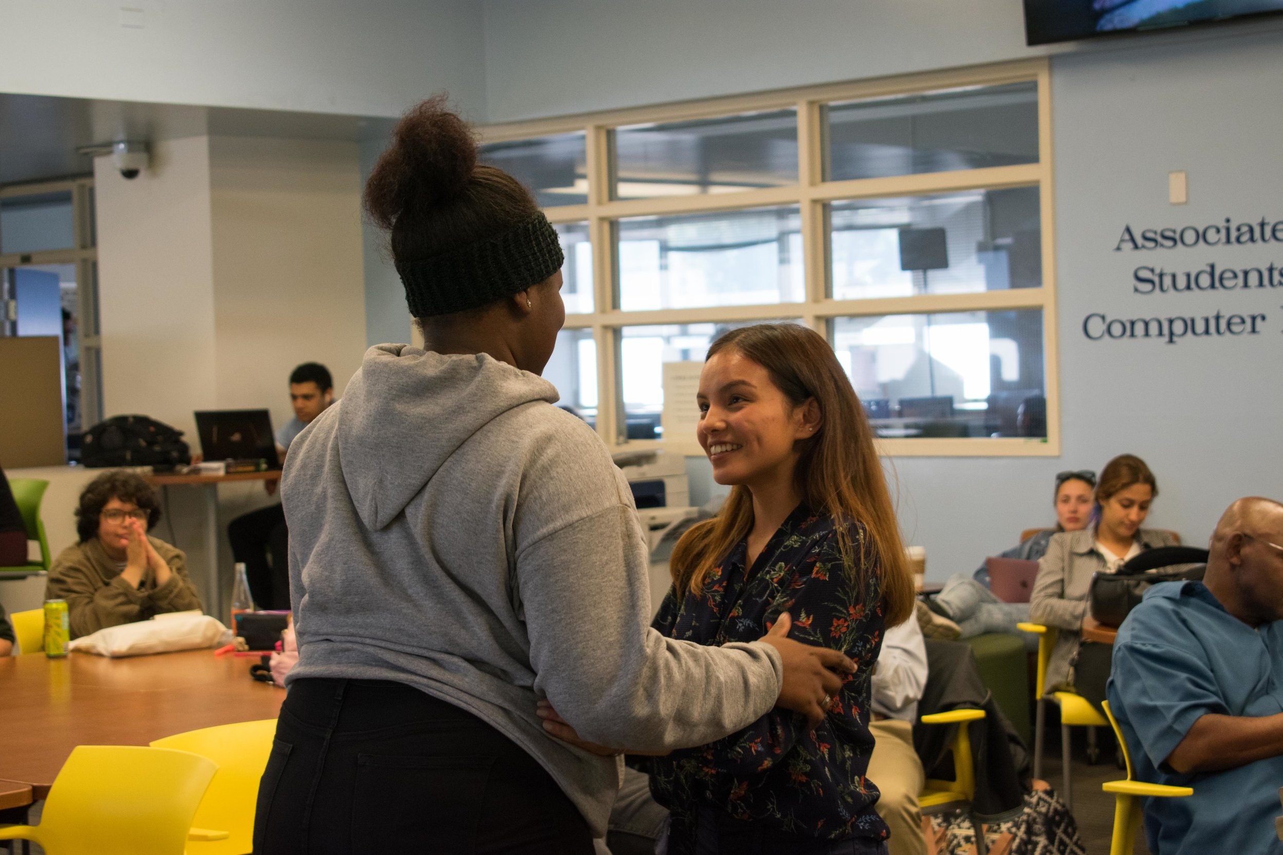 Two candidates for Director of Activites, Jazzmin Sardin hugs interim director Saori Gurung after Gurung is announced to be the primary director at Santa Monica College in Santa Monica, California. (Photo by Ethan Lauren)