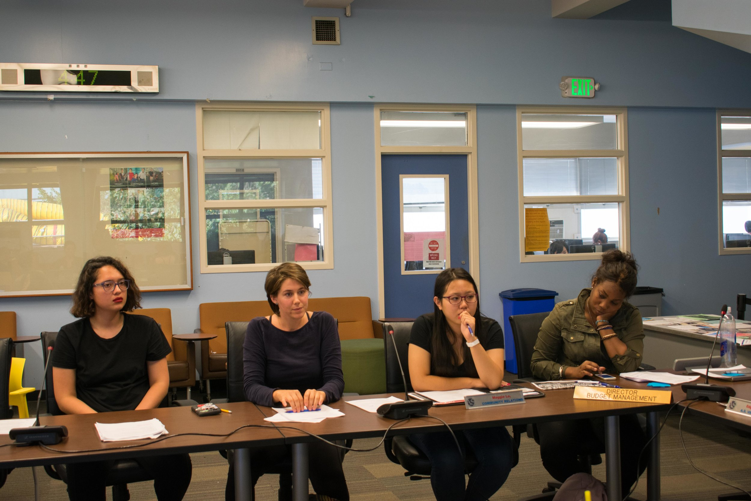 From the left, Stephanie Hernandez and Ana Laura Paiva sit alongside the rest of the board in the new positions of Student assistance and publicity respectively. Also pictured is Maggie Lo, director of community relations and director of budget management, Charlene Alex Boyd at Santa Monica College in Santa Monica, California. (Photo by Ethan Lauren)