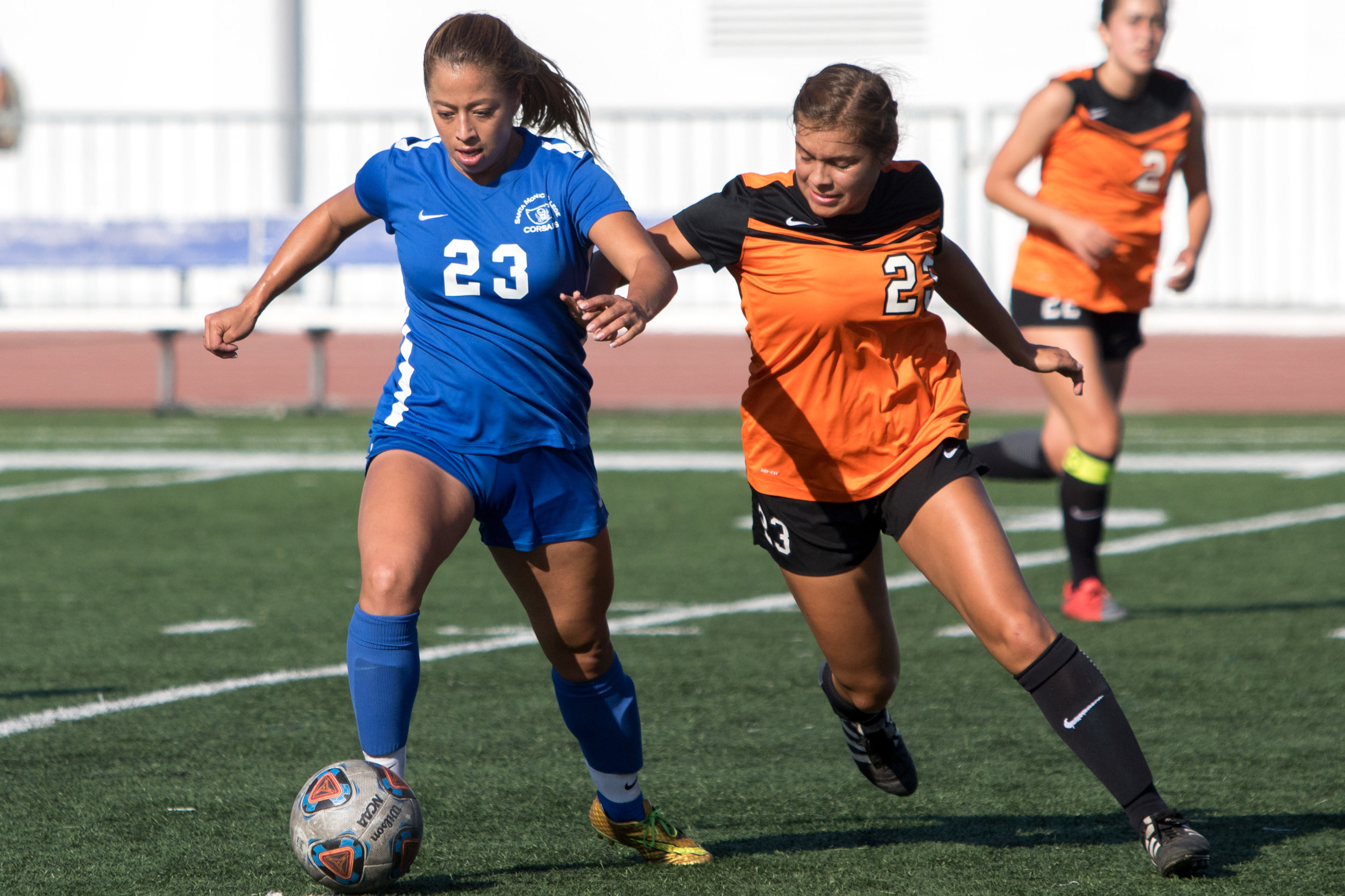 Santa Monica College Corsairs Freshman forward Daysi Serrano (23, left) keeps the ball away from Ventura College Pirates freshman forward Audrey Castillo (24, right). The Corsairs were able to come out with a 2-1 victory at the Corsair Field located on Santa Monica Colleges Main Campus in Santa Monica California on September 26, 2017. (Photo By: Zane Meyer-Thornton)