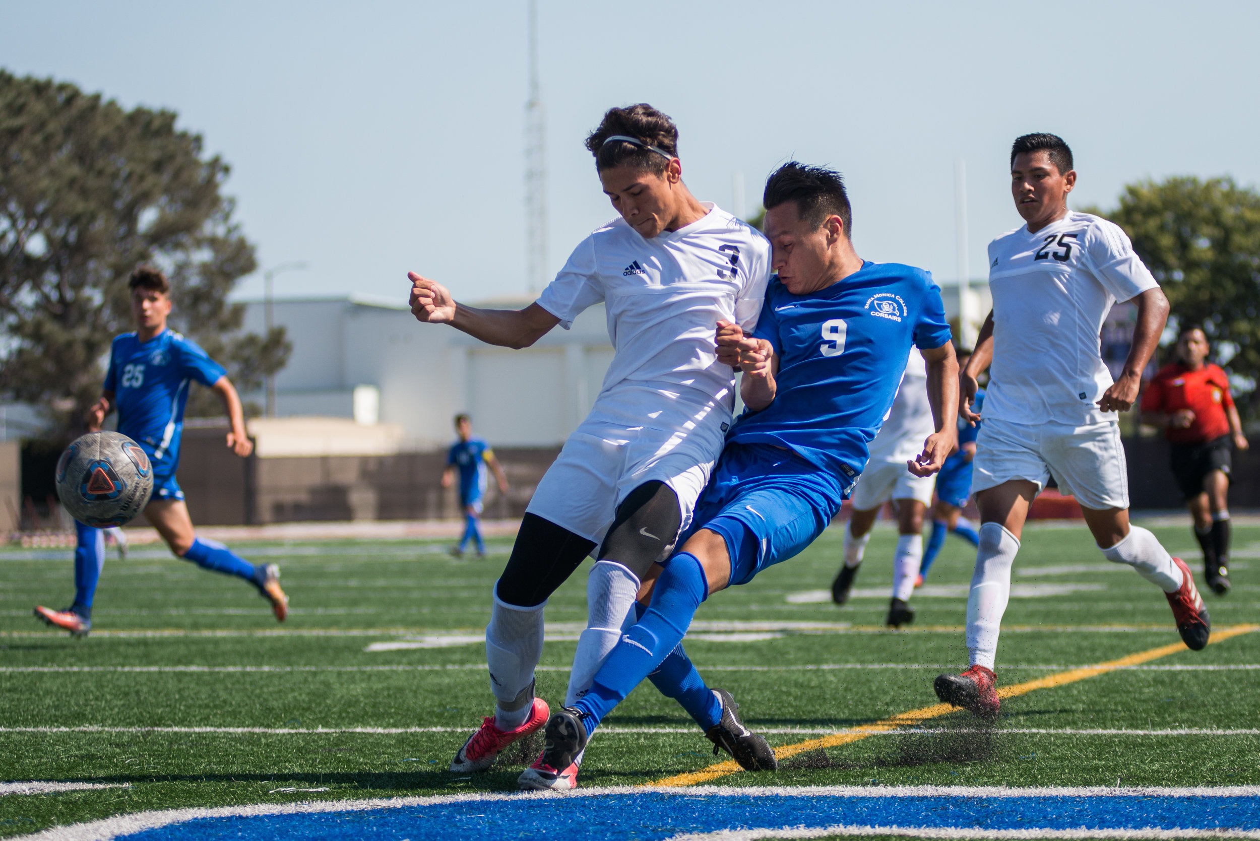 Santa Monica College Corsair Chris Negrete (9) (CTR) contests a pass against Citrus College Owl Jayson Yepez Chavez (3) (L) on Tuesday September 26, 2017 on the Corsair Field at Santa Monica College in Santa Monica, California. The Corsairs tied the game 1-1. (Josue Martinez)