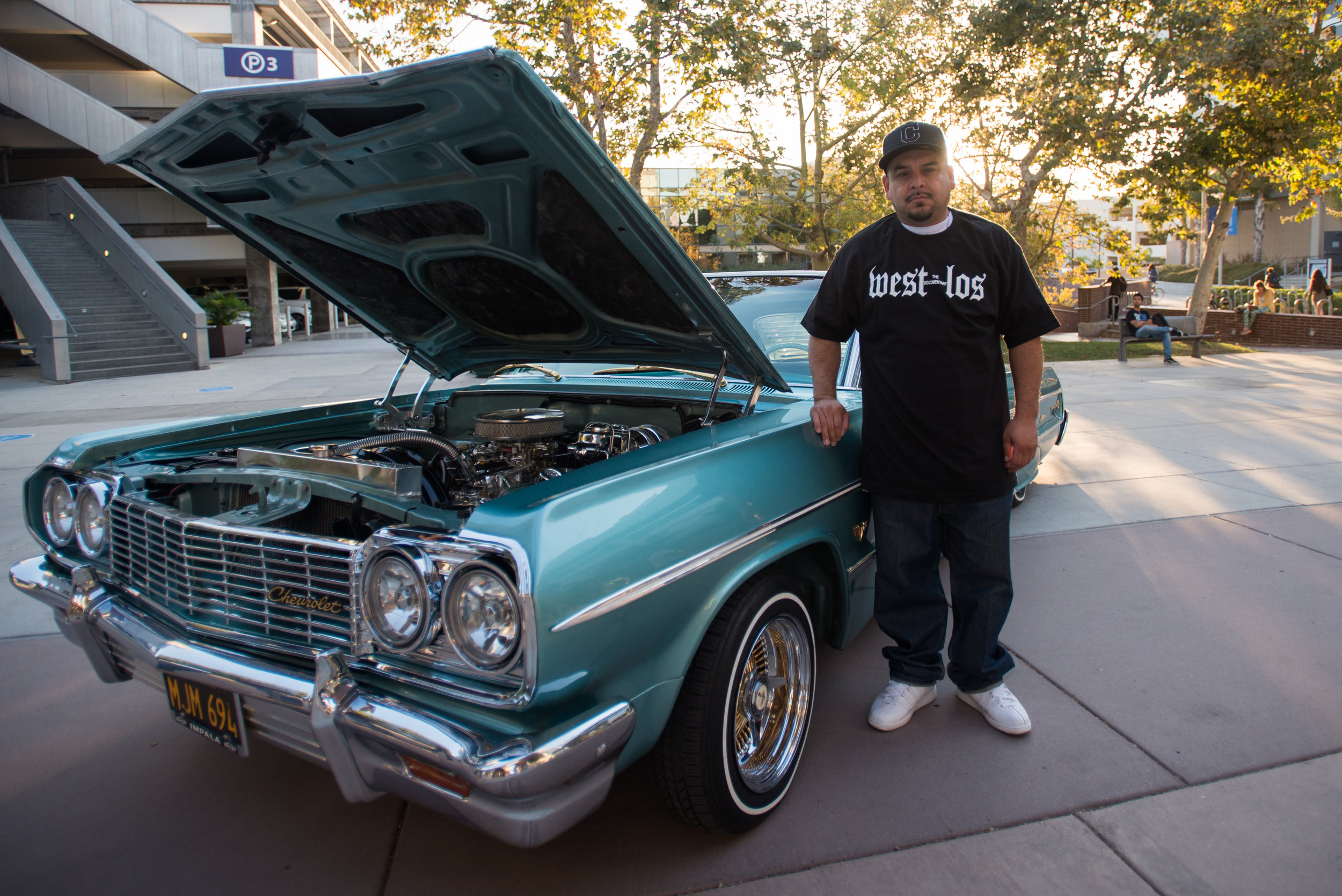 Charlie Chacon producer and creator of West Los:The Documentary poses for a portrait next to his 64' Chevy Impala on Tuesday September 26, 2017 at Santa Monica College Main Campus in Santa Monica, California. (Josue Martinez)