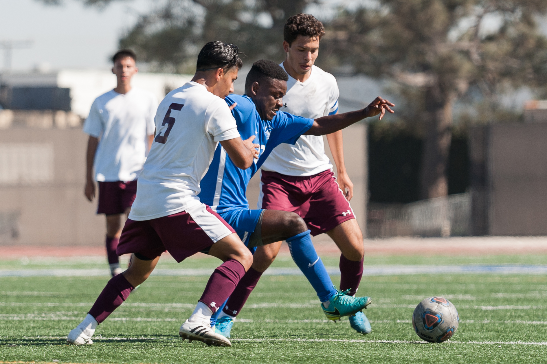 Midfielder Divine Simbu (23,right) of Santa Monica College competes with Angel Barajas (5,left) of Victor Valley College for possession of the ball. The Santa Monica College Corsairs won the game 2-0 against the Victor Valley Rams. The match was held at the Corsair Stadium at Santa Monica College in Santa Monica, Calif. on October 6, 2017. (Photo by: Justin Han/Corsair Staff)