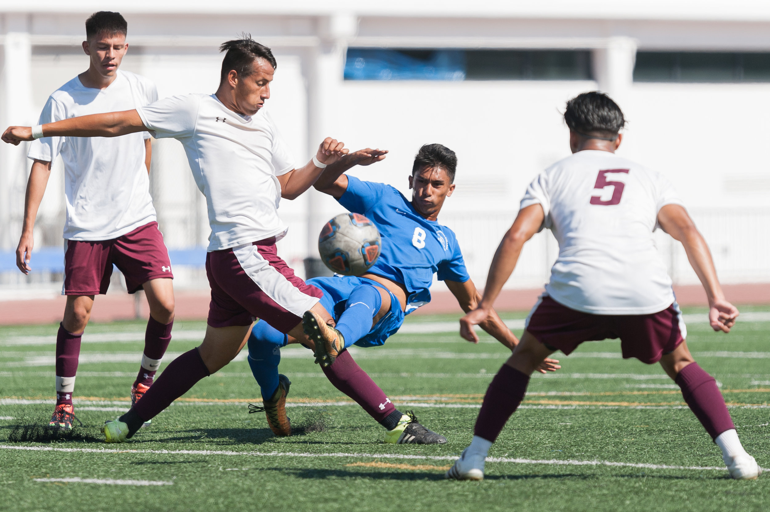 Forward Andy Naidu (8) of Santa Monica College makes a pass through several Victor Valley players. The Santa Monica College Corsairs won the game 2-0 against the Victor Valley Rams. The match was held at the Corsair Stadium at Santa Monica College in Santa Monica, Calif. on October 6, 2017. (Photo by: Justin Han/Corsair Staff)