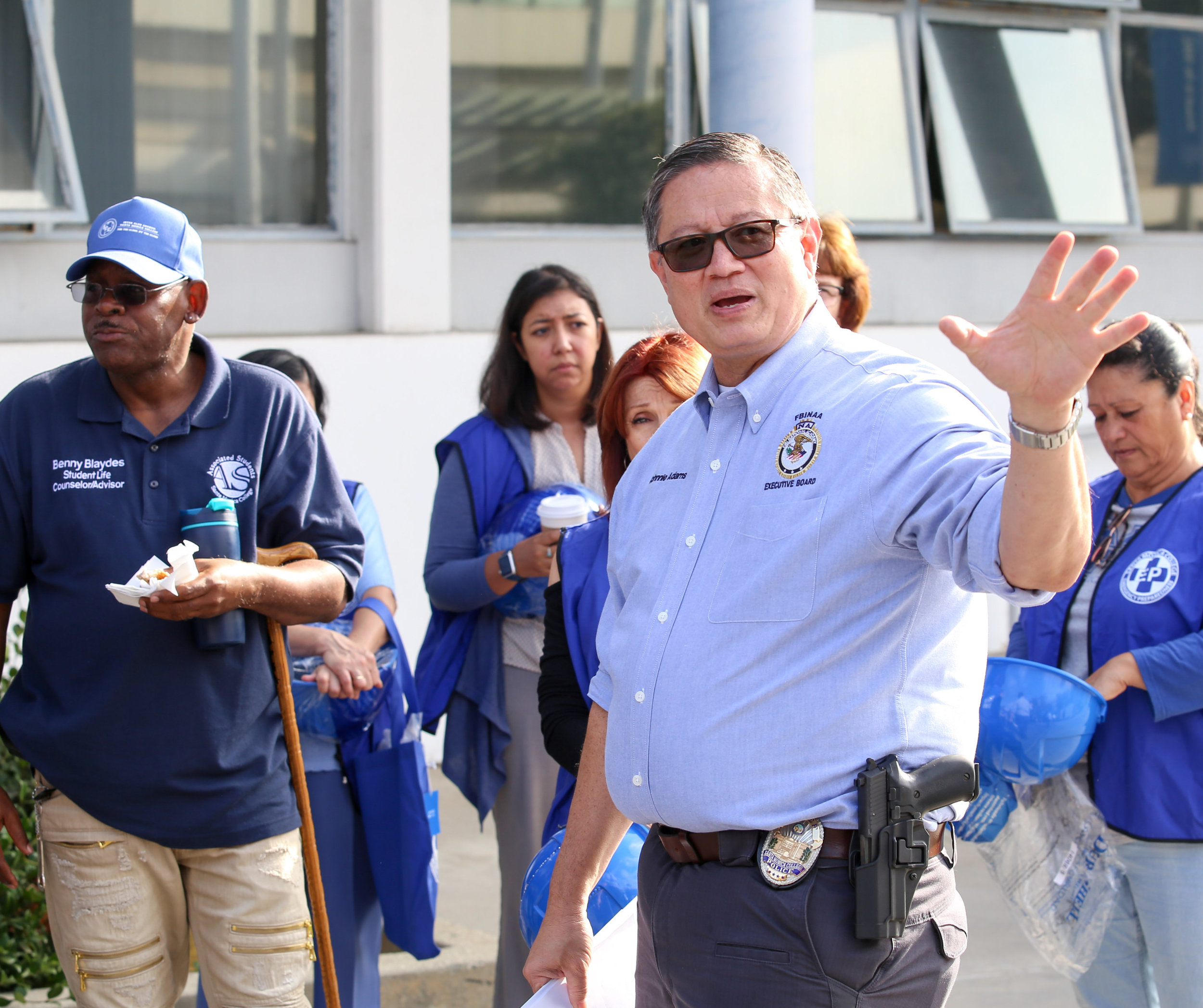 Santa Monica College's Chief of Police Johnnie Adams explains to building monitors and Student Life Counselor and Advisor Benny Blaydes (left) the protocol for submitting their reports back to their command center set up outside of Santa Monica College's Main Campus Library for The Great California Shakedown drill in Santa Monica, Calif on Thursday, October 19th 2017. (Photo by: Thane Fernandes)