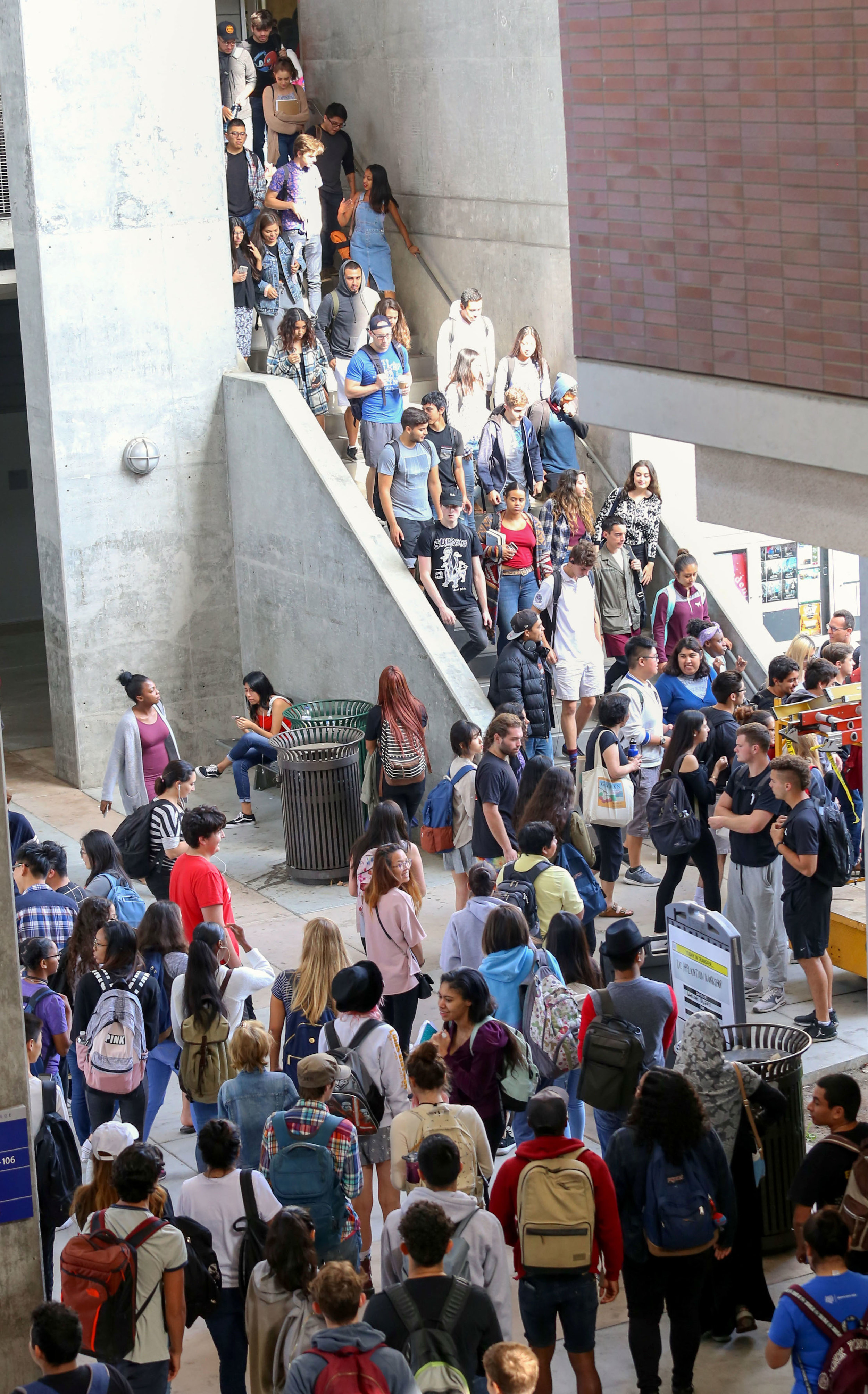 Students evacuate Santa Monica College's History building after an alarm sounded informing students to leave their classroom for The Great California Shakedown drill in Santa Monica, Calif on Thursday, October 19th 2017. (Photo by: Thane Fernandes)