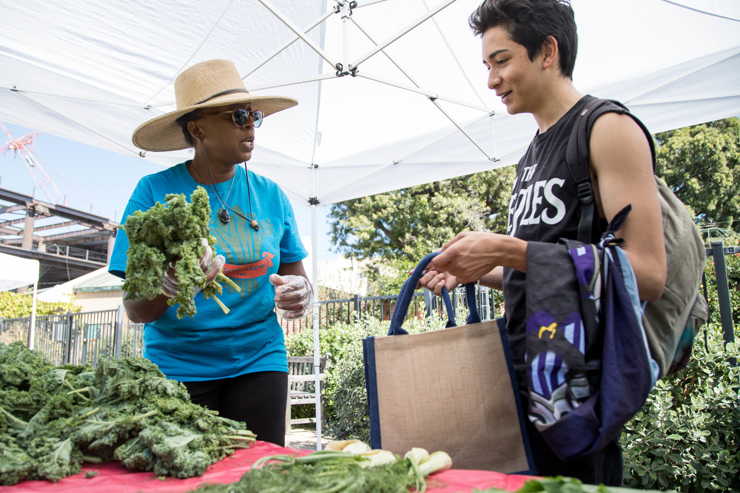 Seventeen year old Santa Monica College student Marco Garcia visits the Free Corsair Farmers Market for the first time on October 16, 2017. He gets advice on how to cook greens from Garden manager Cynthia Kraus during Sustainability Week at SMC in Santa Monica, Calif. (Photo: Jazz Shademan)