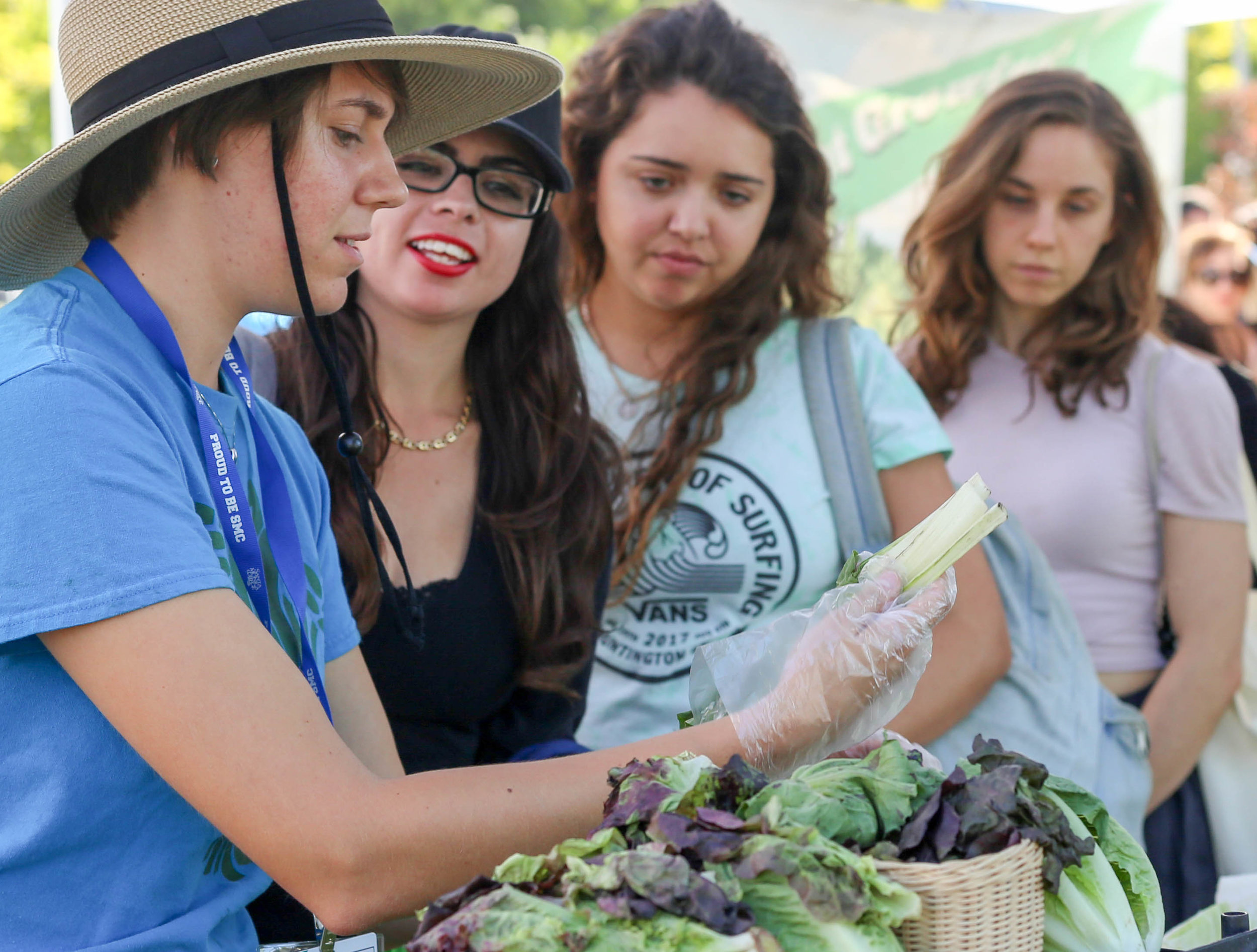 Student Assistant with Santa Monica College's Associated Students Ana Laura Paiva picks out a leak for an SMC student near the Organic Learning Garden at Santa Monica College's Main Campus in Santa Monica, Calif on Monday, October 16th 2017. (Photo by: Thane Fernandes)