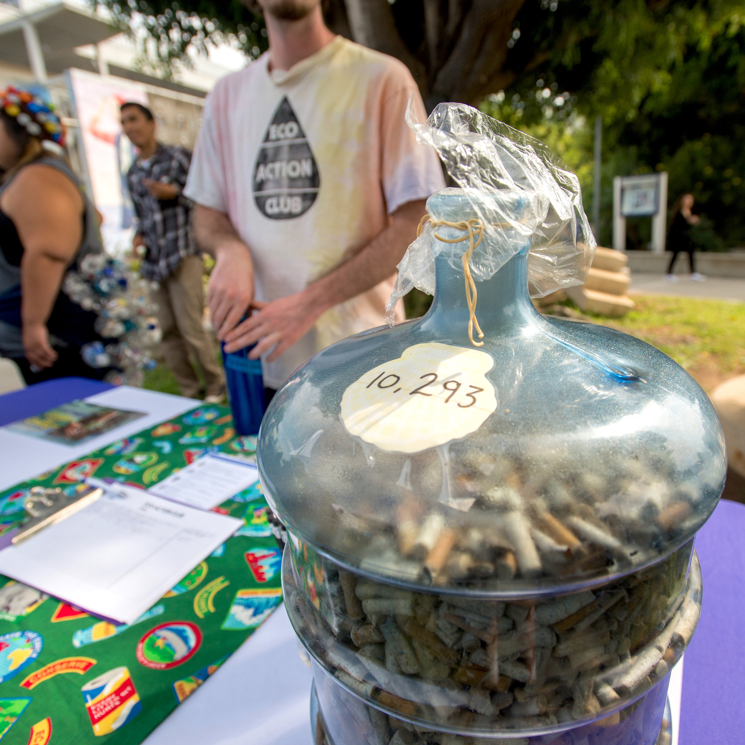 The Eco Action Club displays a water gallon container with the number of cigarette buds filled inside it; which were collected at a beach clean-up, during the Sustainability Week held at Santa Monica College, in Santa Monica, California on October 17, 2017. (Josue Martinez)