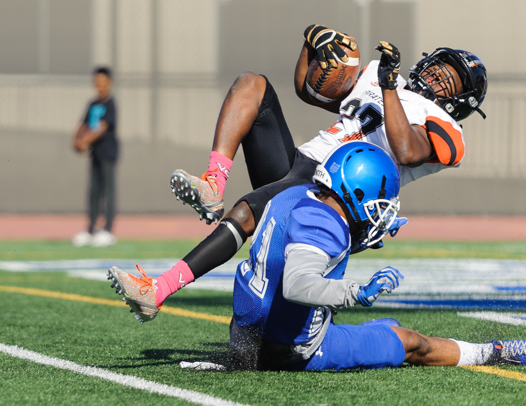Wide receiver Aveon Irving (27) of Ventura College jumps into the endzone for a touchdown despite being tackled by Skye Germaine (21) of Santa Monica College. The touchdown was later waived off as there was a flag during the play. The Santa Monica College Corsairs lose to the Ventura College Pirates 0-55. The game was held at the Corsair Stadium at the Santa Monica College Main Campus in Santa Monica, Calif.. October 21, 2017. (Photo by: Justin Han/Corsair Staff)