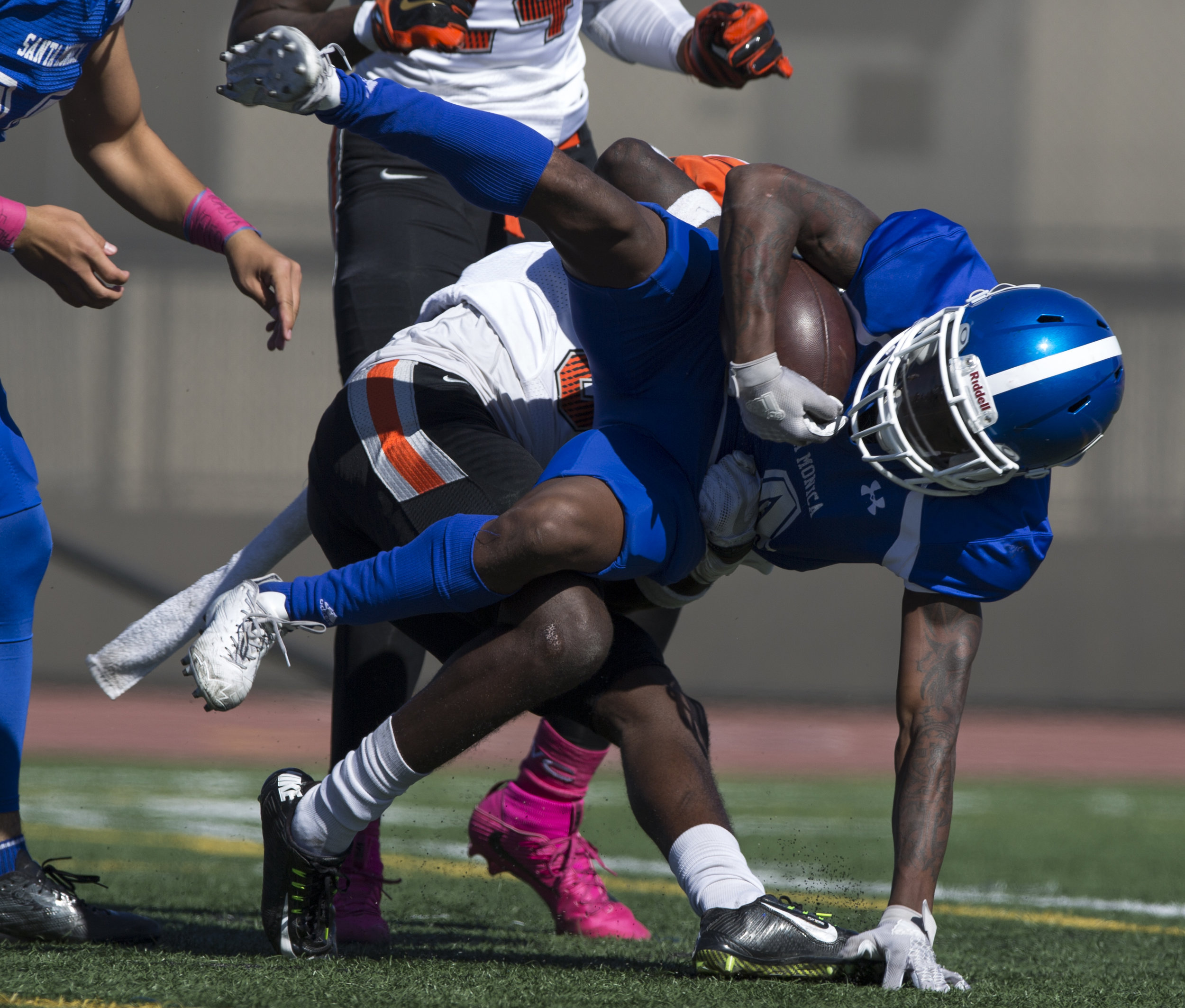Santa Monica College Corsair wide receiver Franklin Cristian (4) gets tackled by Ventura College Pirate defensive back Jon Hughes (33) on the Corsair Field at Santa Monica College on October 21, 2017 in Santa Monica, California. Corsairs lose to the Pirates 55-0. (Jose Lopez)