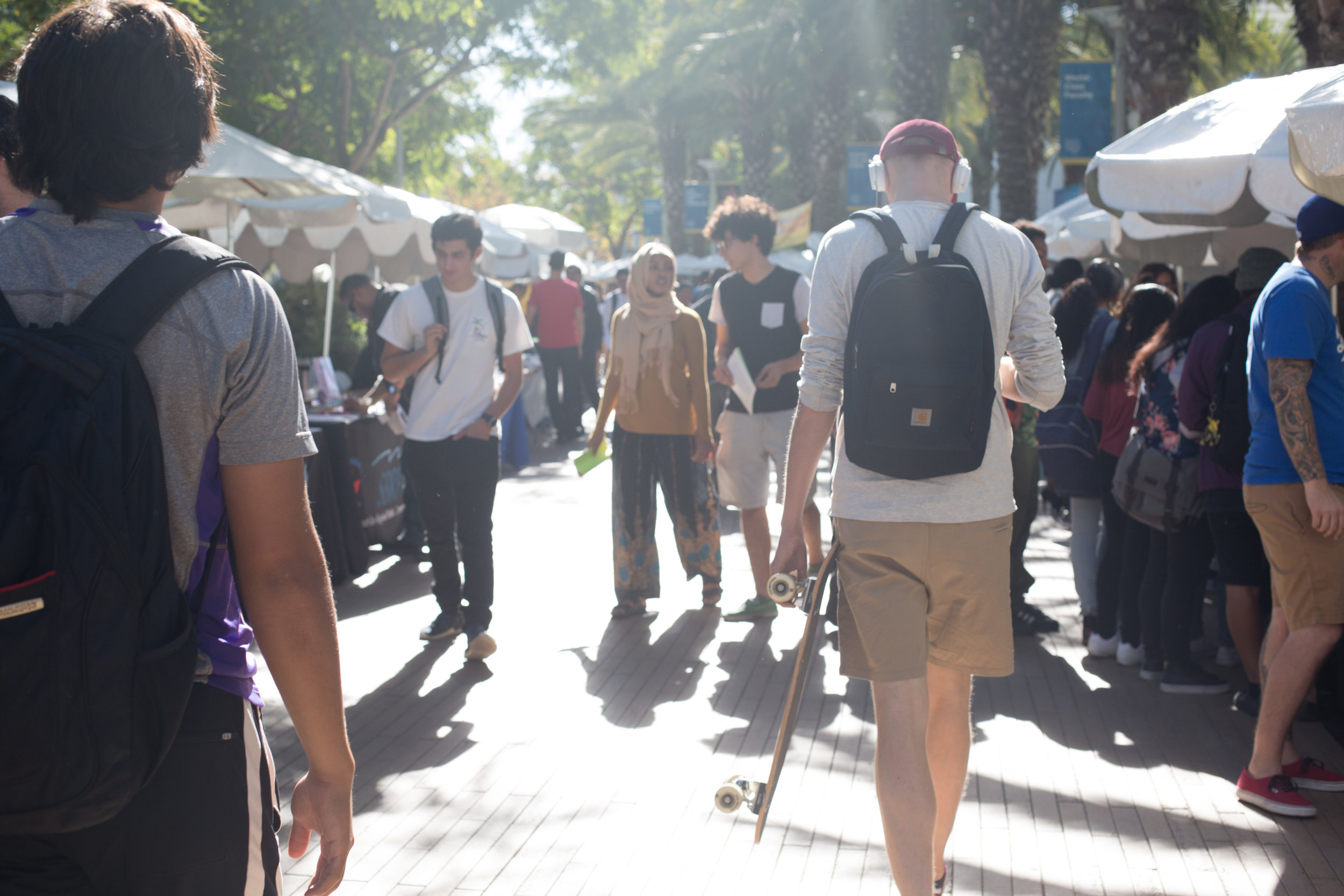 Students approach booths to inquire about emplyment opportunities at the Job Fair held at the Main Quad of Santa Monica College's Main Campus in Santa Monica, Calif., October 24, 2017. (Photo By: Ripsime Avetisyan/Corsair Staff)