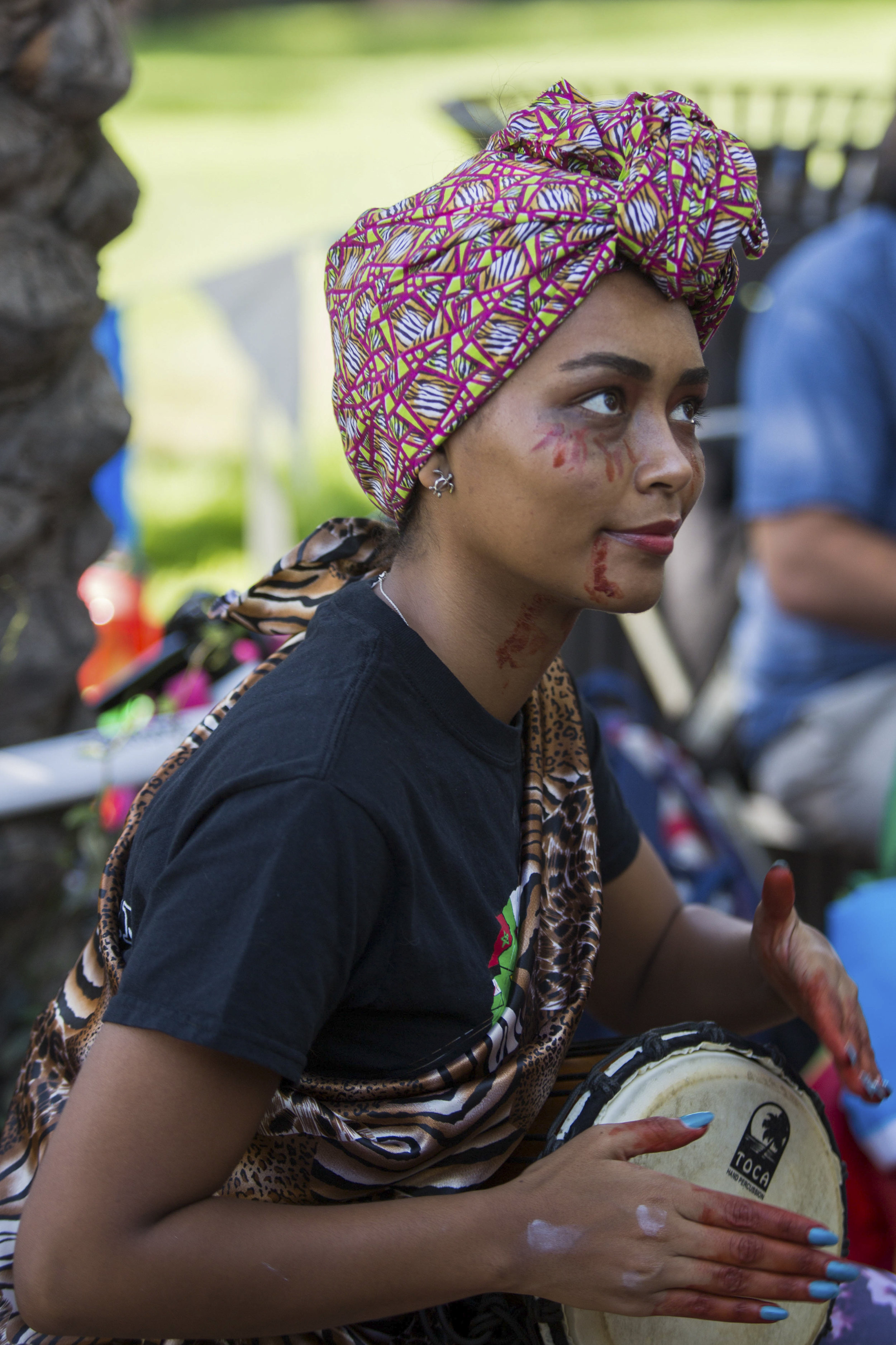 Hilsenbek-steffie Yema, member of Pan-African Student Union plays Toca drum at their club's booth during Club Row event at Santa Monica College Main Campus on Thursday, October 26th, 2017 in Santa Monica, California. (Photo by Yuki Iwamura)