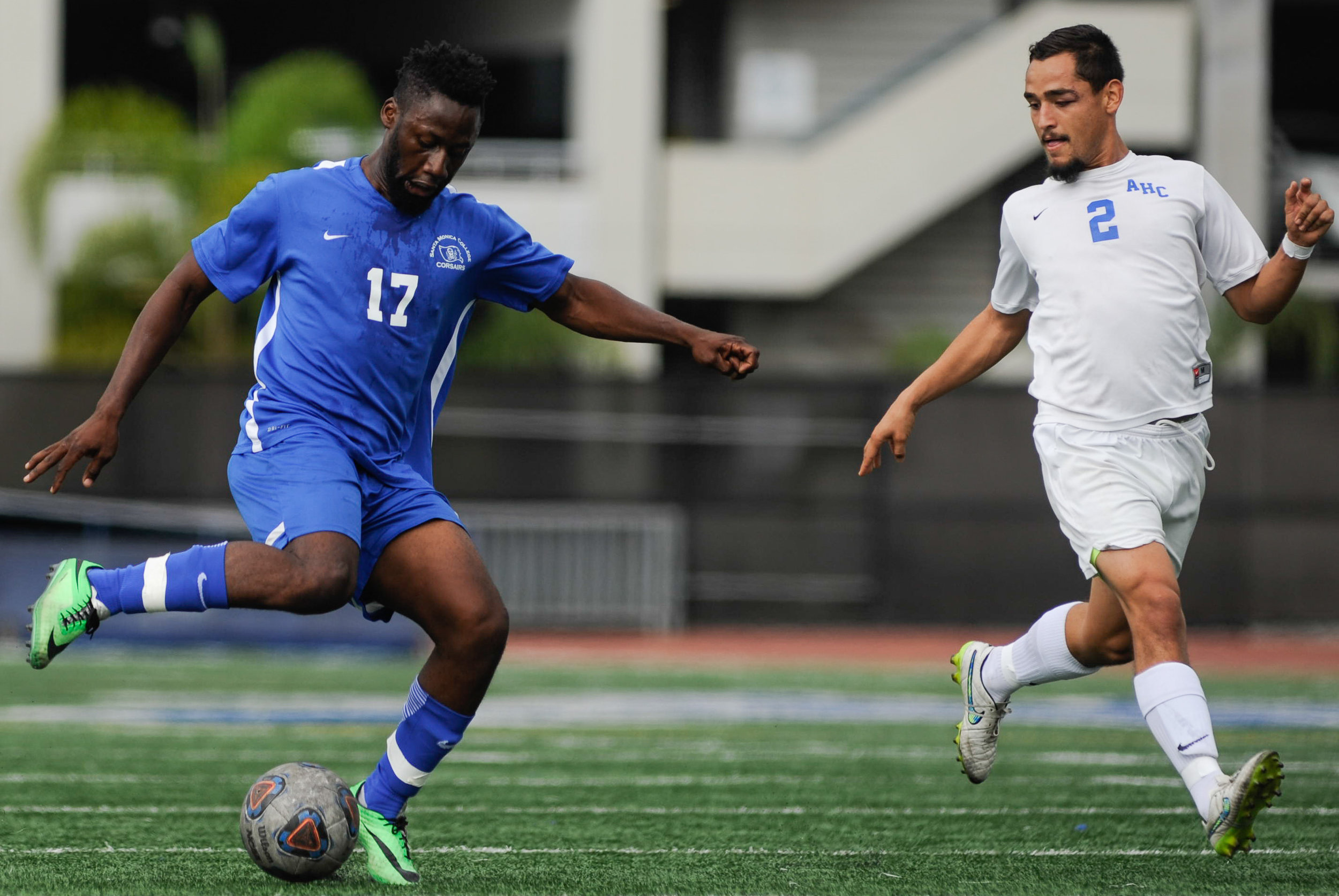 Midfielder Cyrille Njomo (17) of Santa Monica College fakes a pass while being guarded by defender Mario Delgado (2) of Allan Hancock College. The Santa Monica College Corsairs end the game tied with the Allan Hancock College Bulldogs 1-1. The match was held at the Corsair Stadium at the Santa Monica College Main Campus in Santa Monica, Calif.. October 31, 2017. (Photo by: Justin Han/Corsair Staff)