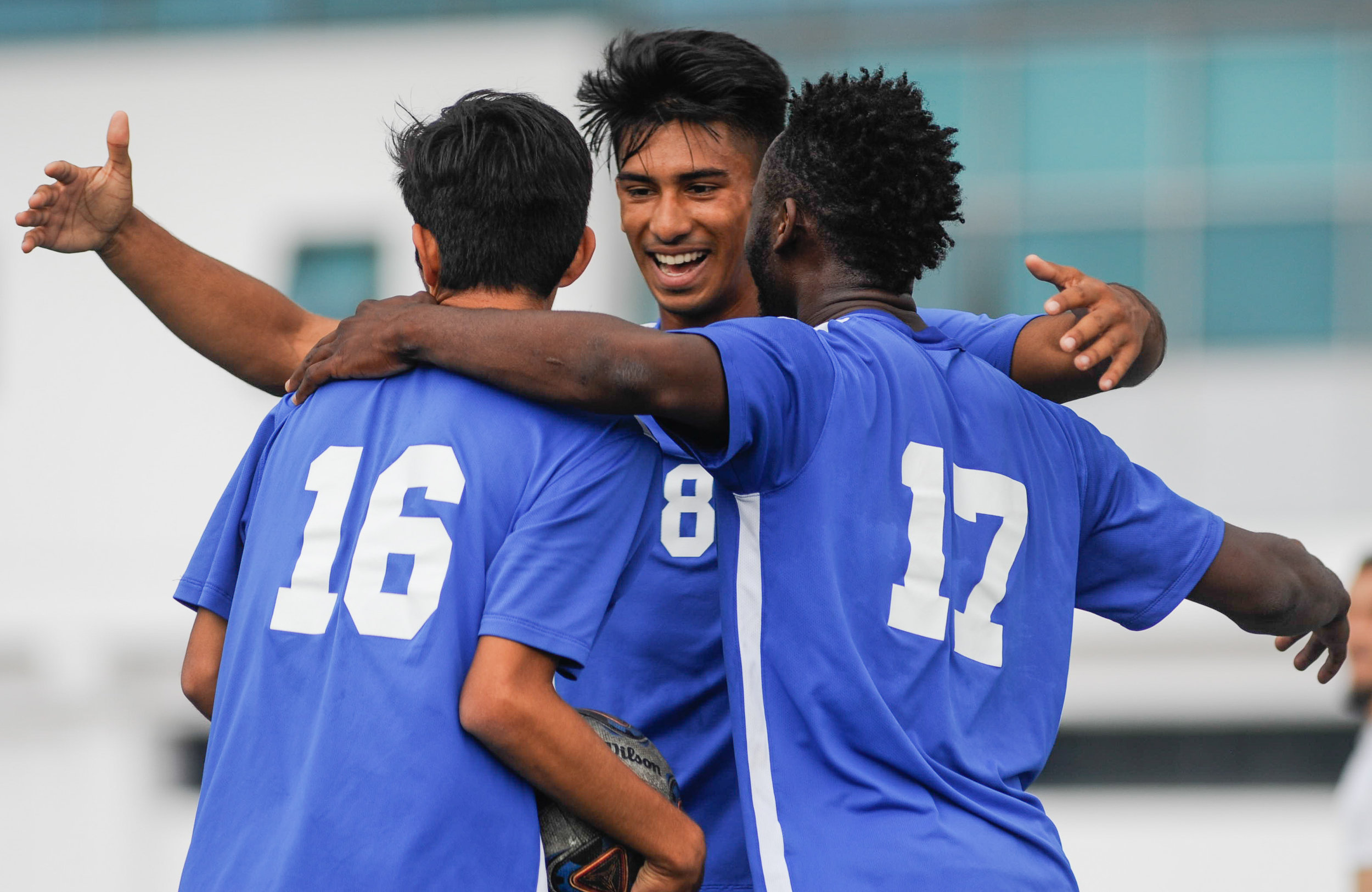 Midfielder Carlos Rincon (16,Left) is embraced by forward Andy Naidu (8,Middle), and midfielder Cyrille Njomo (17,Right) of Santa Monica College as they celebrate Rincon's goal in the first half, the only goal scored by the Corsairs in the match. The Santa Monica College Corsairs end the game tied with the Allan Hancock College Bulldogs 1-1. The match was held at the Corsair Stadium at the Santa Monica College Main Campus in Santa Monica, Calif.. October 31, 2017. (Photo by: Justin Han/Corsair Staff)