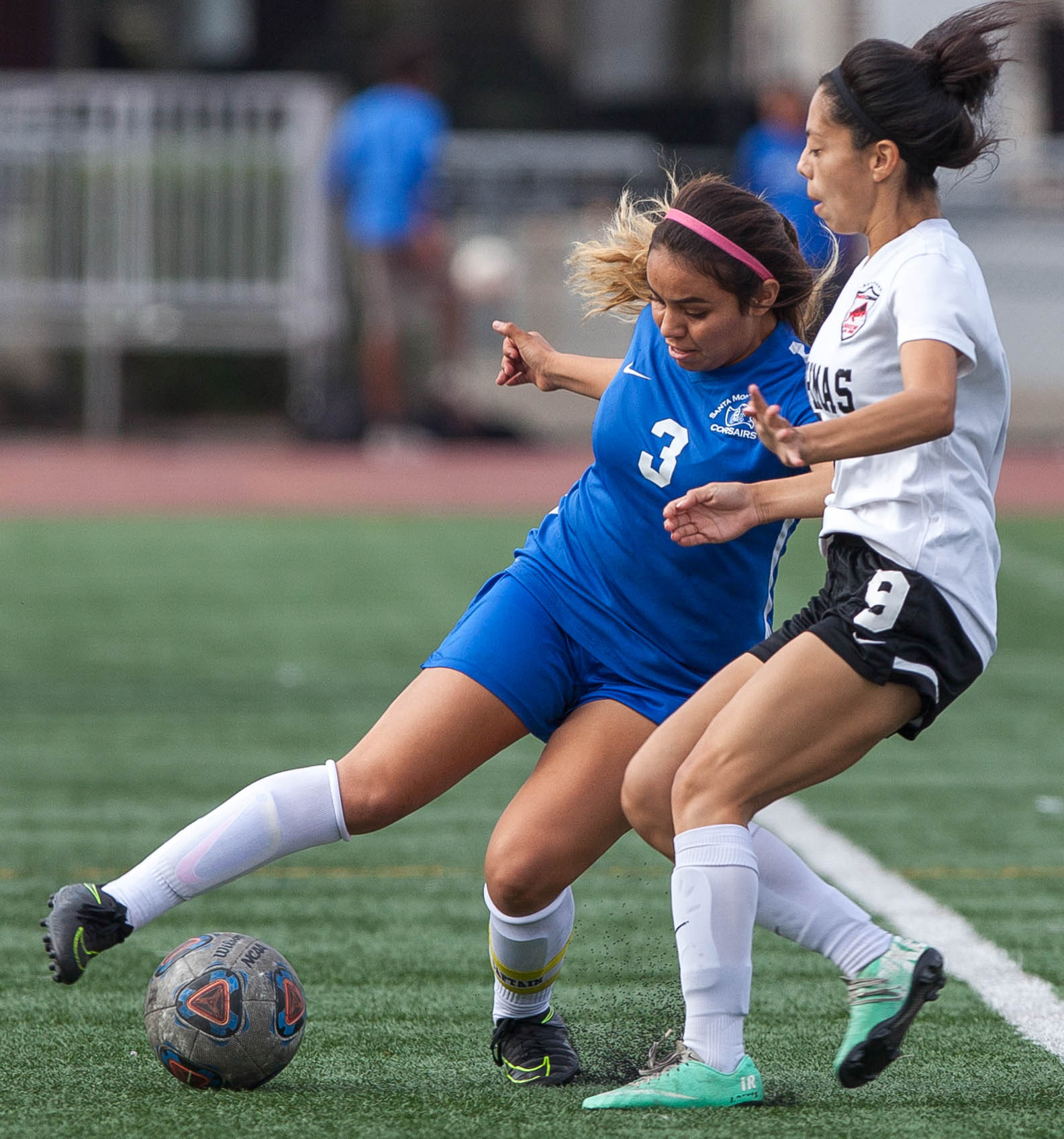 Santa Monica College Corsair Chrystal Dorado (3) protects the ball from Pierce College Brahma Irene Reyes (9) on the Corsair Field at SMC on Tuesday, October 31, 2017 in Santa Monica, Calif. Corsairs win against the Brahmas 1-0 . (Elena Rybina)
