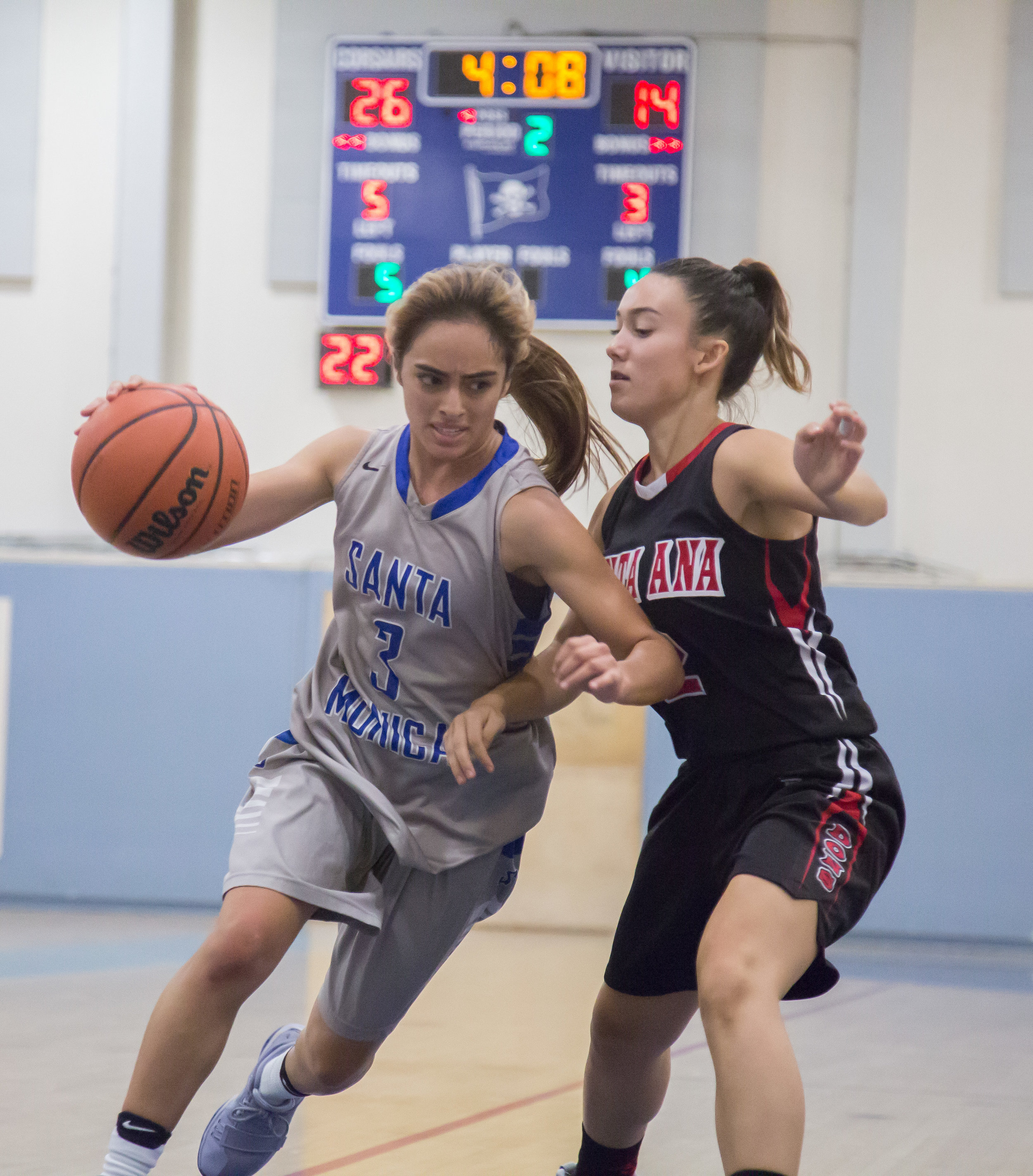Guard Luna Rivera (3) of Santa Monica College Corsairs attempt to evade block by Guard Sally Morris (2) of Santa Ana College during 2nd period of their 2nd game of the season. Santa Monica College Corsairs win the game 63-54 against Santa Ana College. On Saturday, November 4th, 2017 at the SMC Pavilion on the Santa Monica College Main Campus in Santa Monica, California. (Photo by Yuki Iwamura)