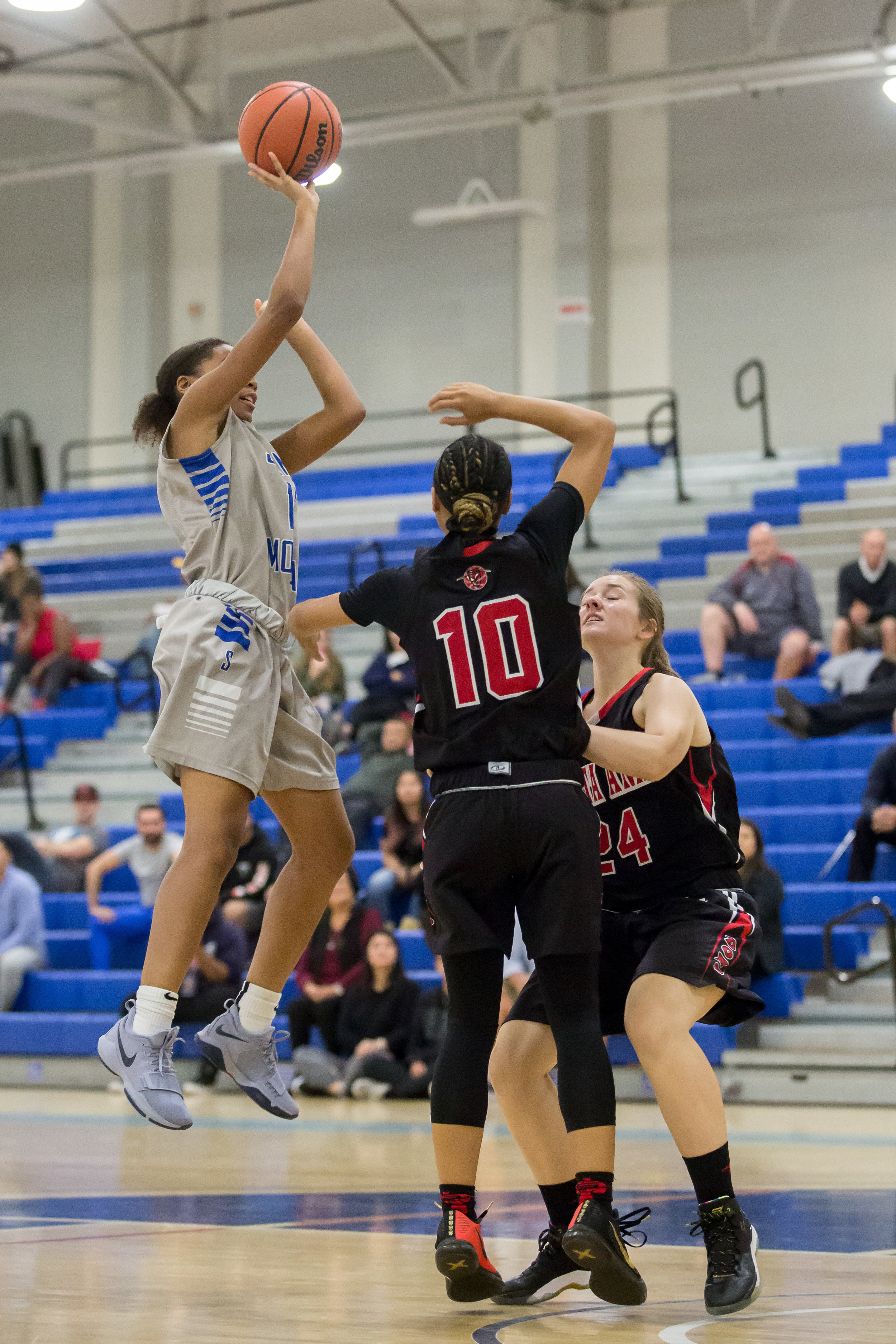 Forward Jazzmin Oddie (12) of Santa Monica College shoots a floater over  Guard Candace Black (10) and Guard Alexis Smith (24) of Santa Ana College. Santa Monica College Corsairs win the game 63-54 against Santa Ana College. On Saturday, November 4th, 2017 at the SMC Pavilion on the Santa Monica College Main Campus in Santa Monica, California. (Photo by Yuki Iwamura)