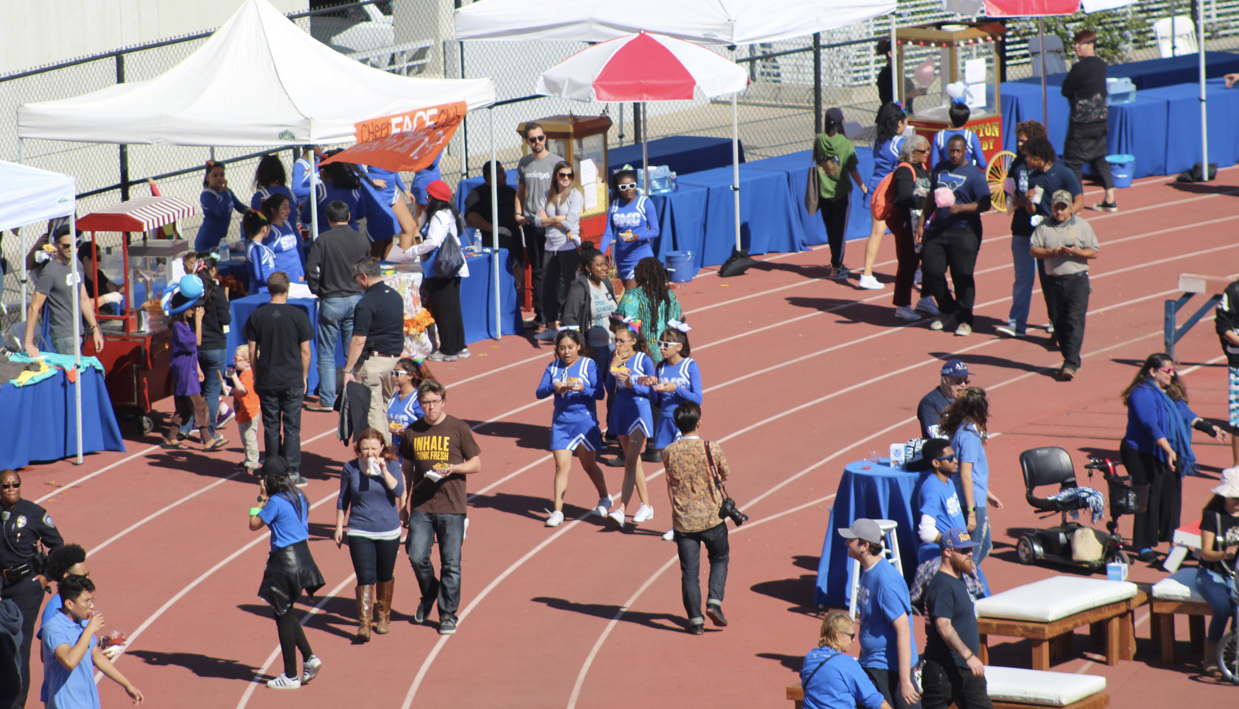 Santa Monica College students, alumni, and fans enjoying the pregame Tailgate Party on the athletic field at SMC during Homecoming 2017 on Saturday November 4, 2017. (Photo by Jessica Uhler )