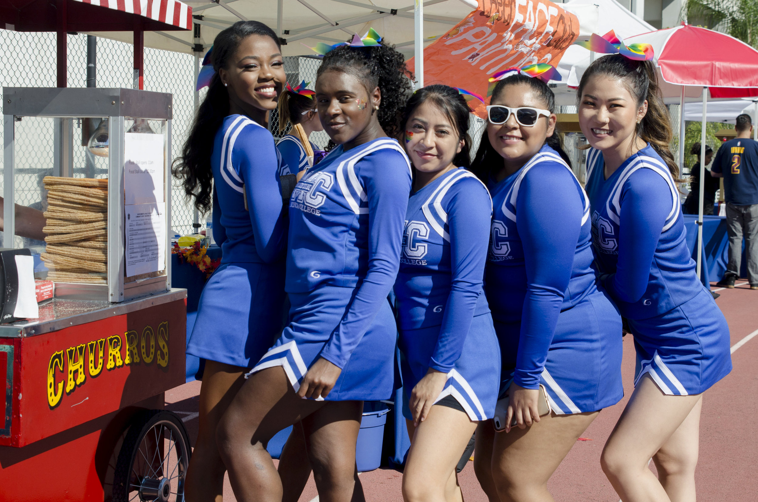 Santa Monica Cheerleaders pose as they wait to get the free churros before the start of the homecoming game.  Santa Monica College football field in Santa Monica,Calif. November 4, 2017. (Photo by: Diana Parra Garcia)
